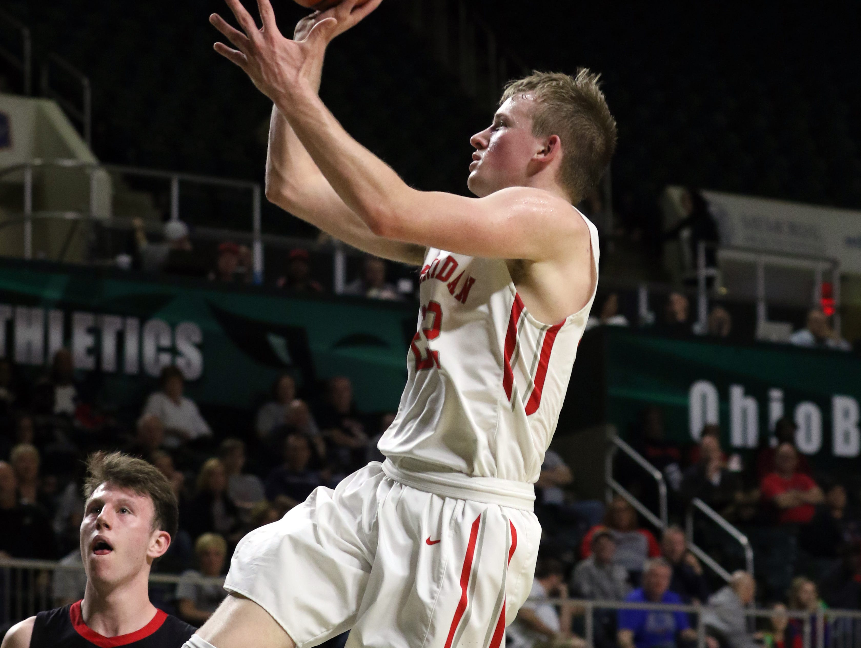 Sheridan's Landen Russell puts up a shot against Steubenville in the Division II regional semifinals Wednesday in Athens.