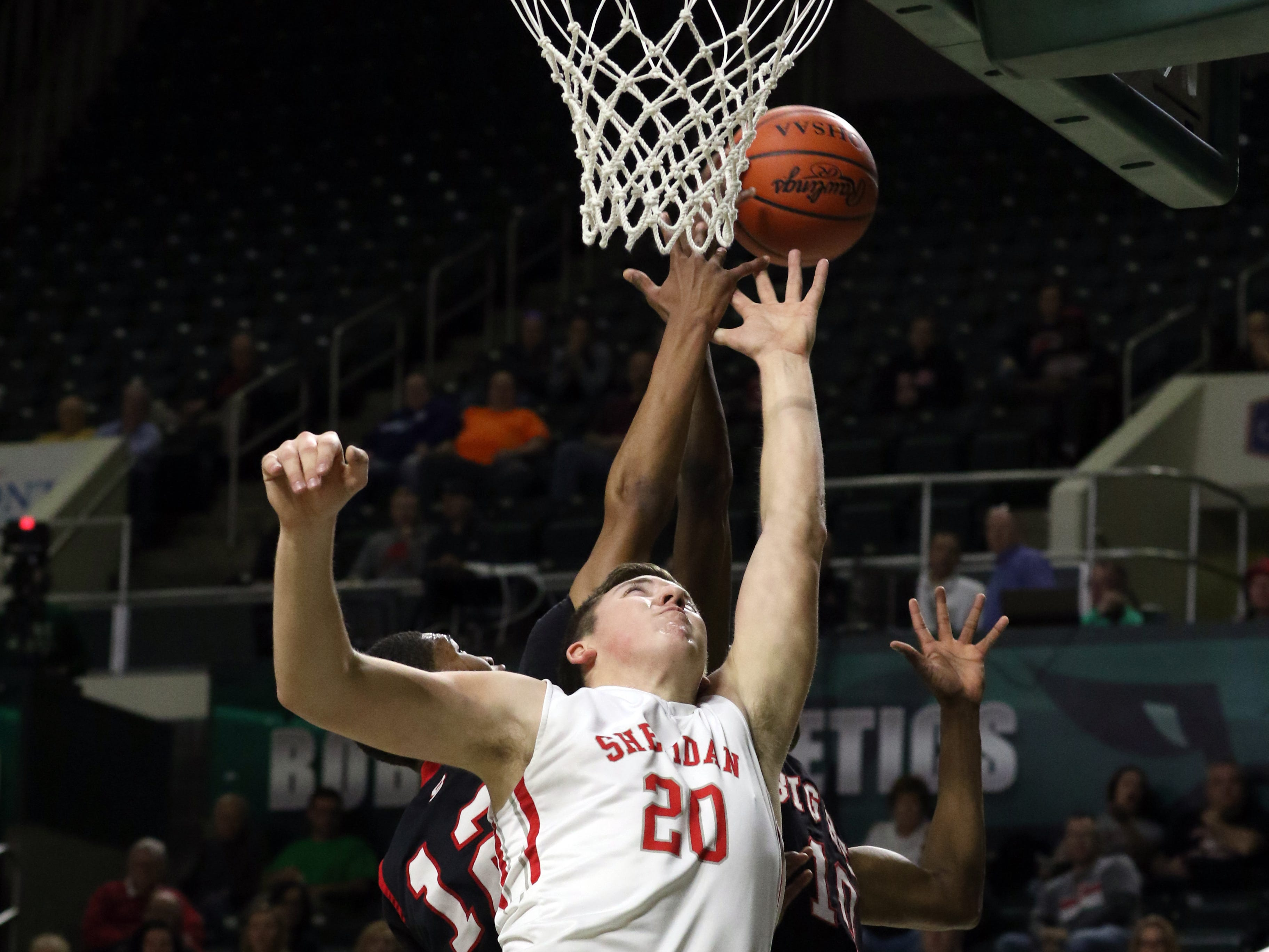 Sheridan's Adam Boyle reaches for a rebound against Steubenville in the Division II regional semifinals Wednesday in Athens.