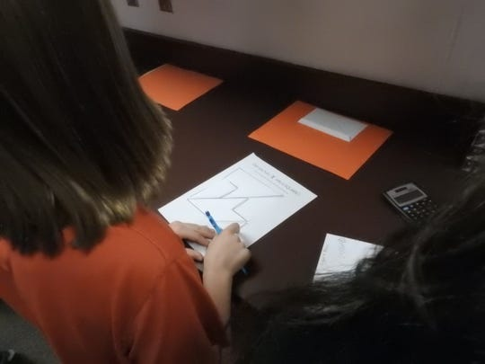 Students had to solve a variety of puzzles, including rearranging sections of the pi symbol into a square, to find clues to open the lock box.
