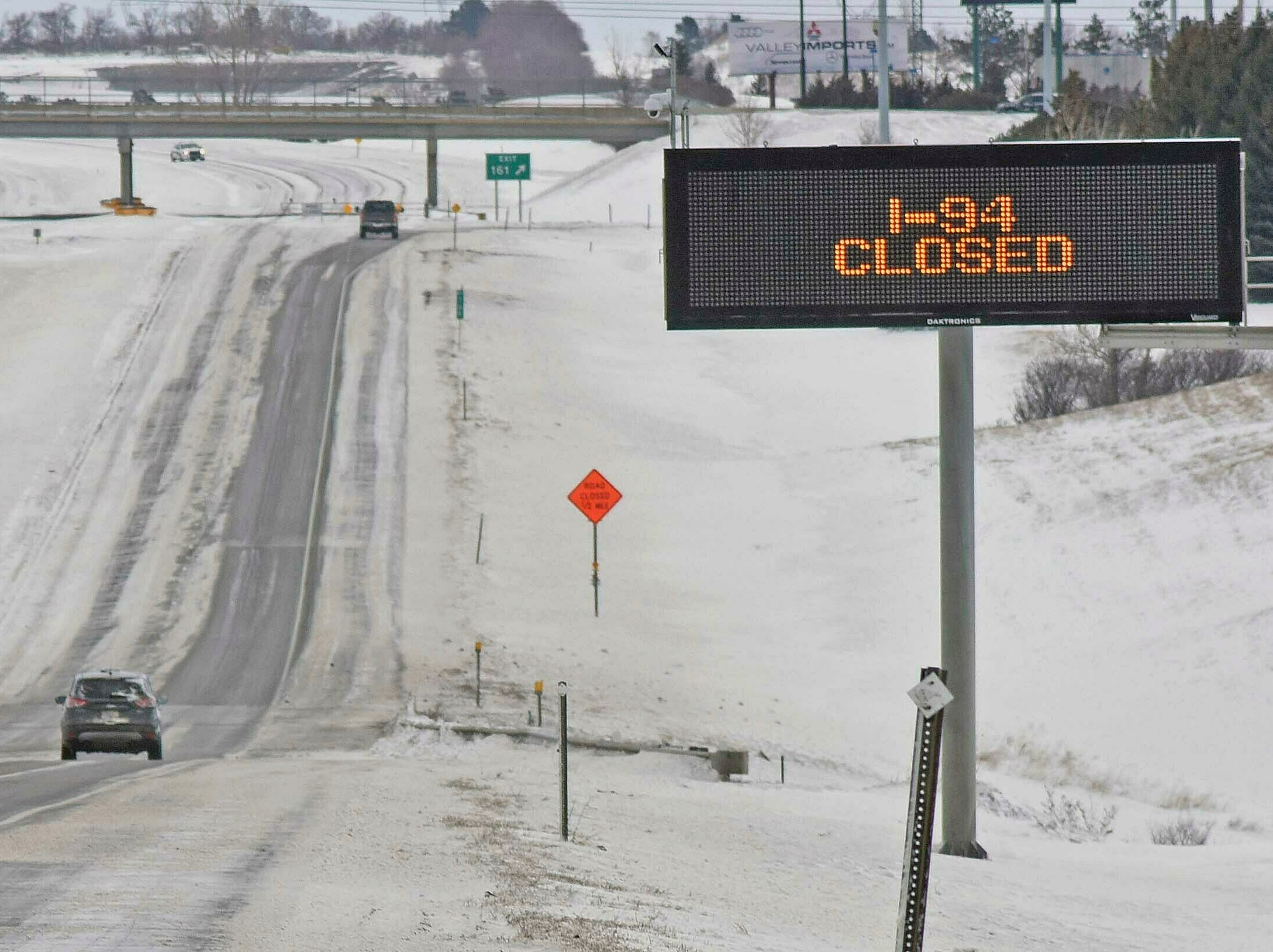 The eastbound lanes of Interstate 94 were closed at Exit 161 on Wednesday evening and remained closed Thursday, March 14, 2019 until snowplows could clear the east-west interstate highway of drifted snow near Bismarck.   North Dakota transportation officials closed sections of major interstates after blowing snow reduced visibility to nearly zero.