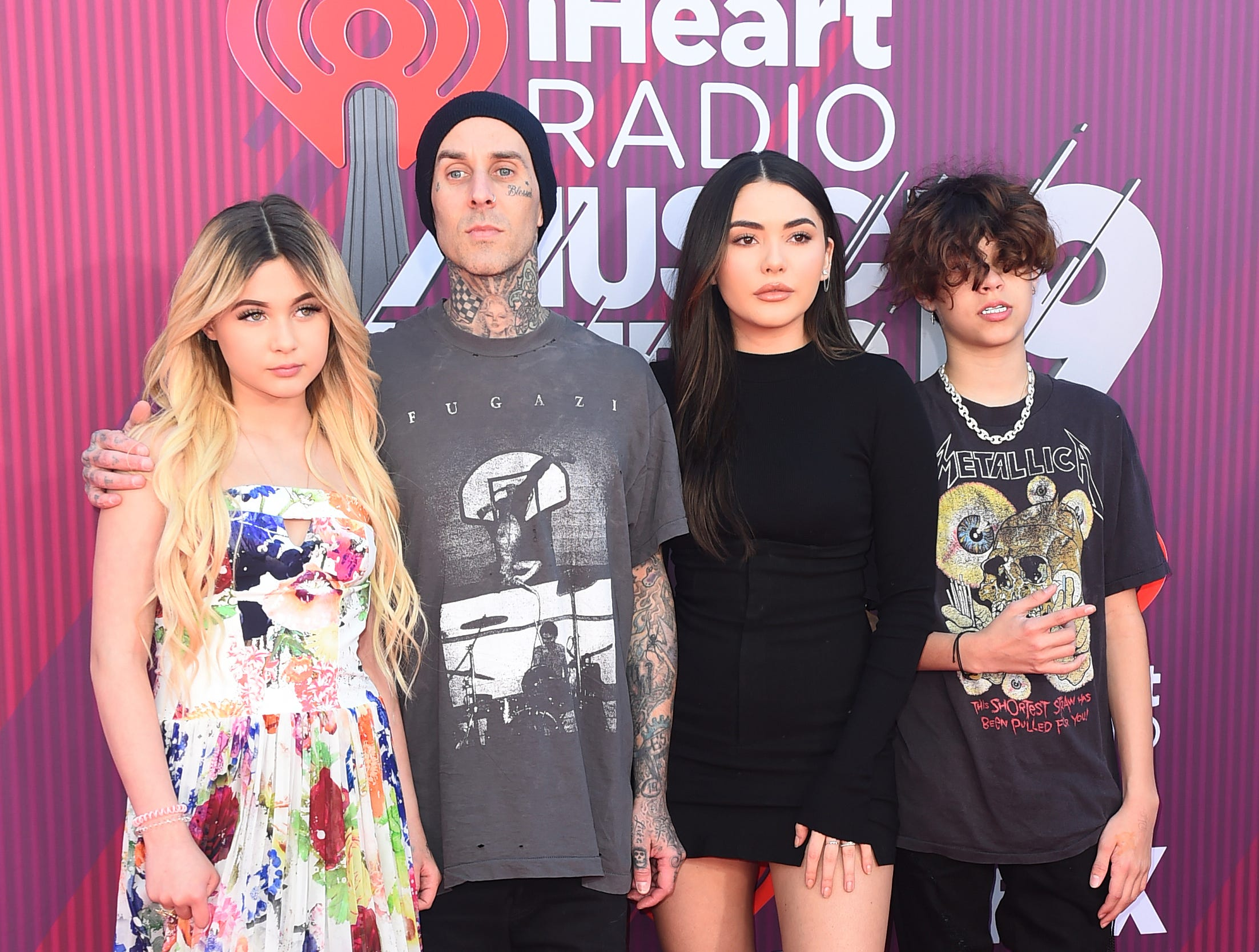 Alabama Luella Barker, from left, Travis Barker, Atiana de la Hoya and Landon Asher Barker arrive at the iHeartRadio Music Awards.
