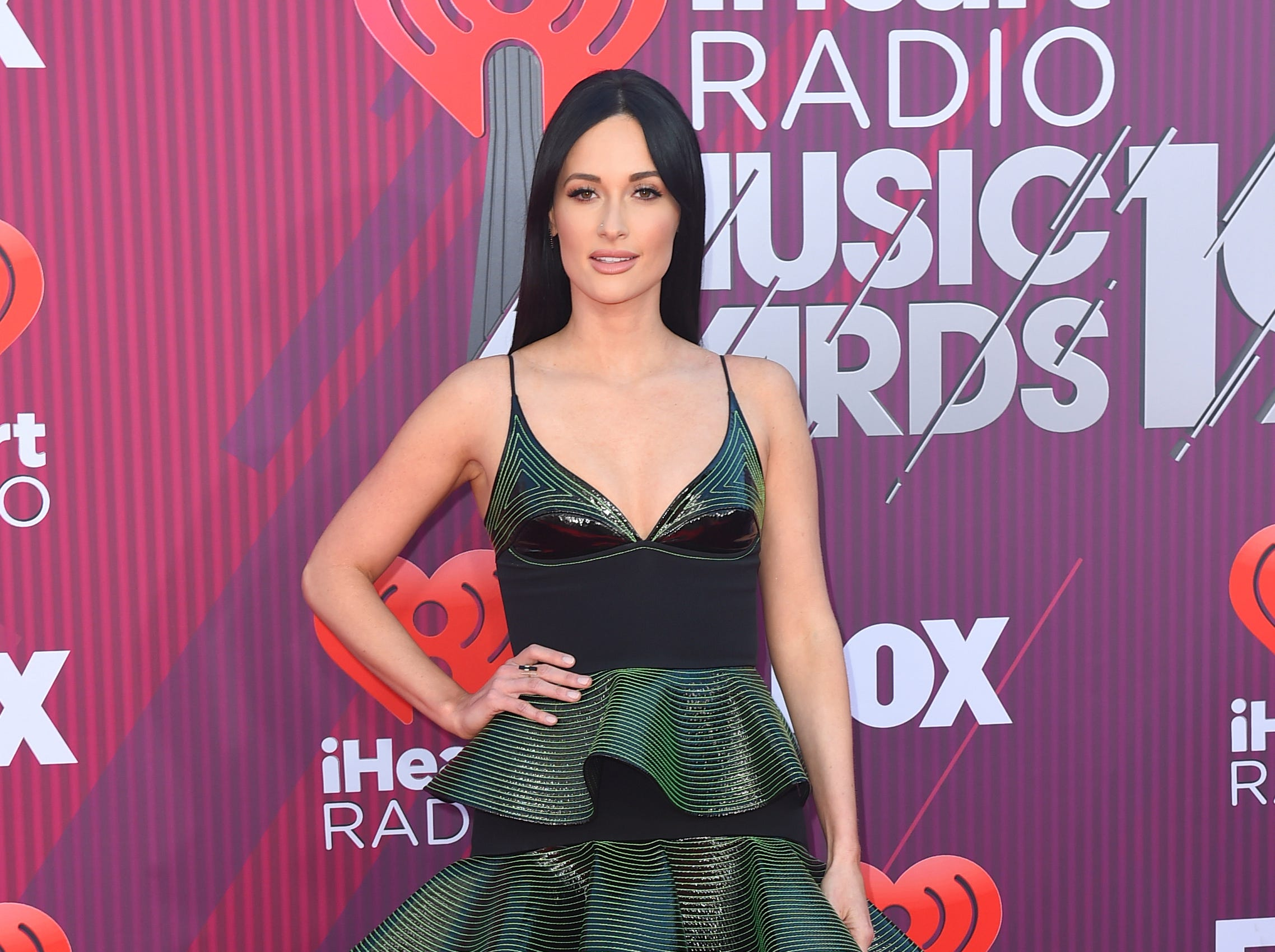 Kacey Musgraves arrives at the iHeartRadio Music Awards.