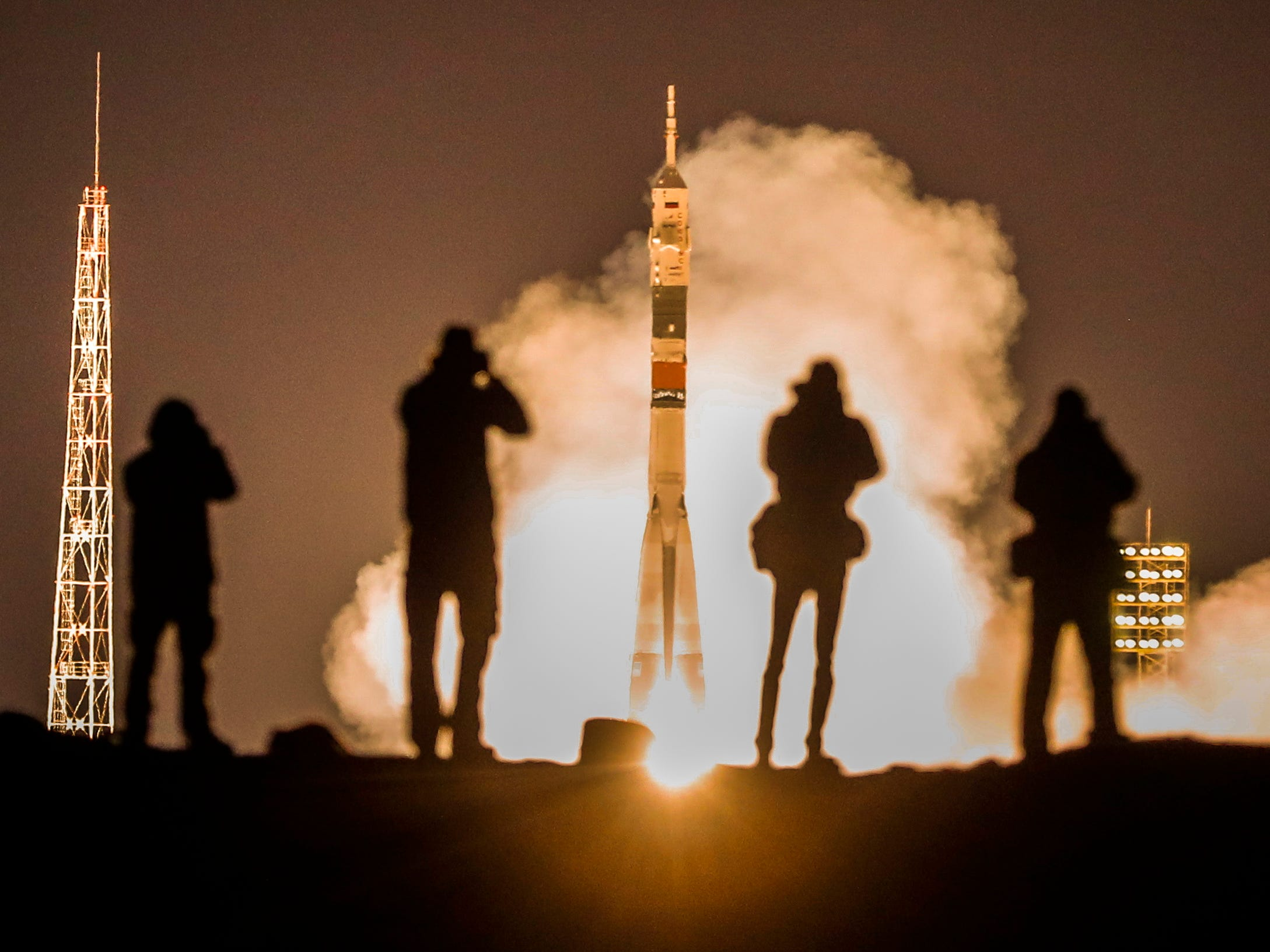 Photographers take pictures as the Soyuz MS-12 spacecraft with crew members of Expedition 59/60  Russian cosmonaut Alexey Ovchinin, NASA astronauts Christina Koch and Nick Hague lifts off from the launch pad at the Russian leased Baikonur cosmodrome, Kazakhstan on March 15, 2019.