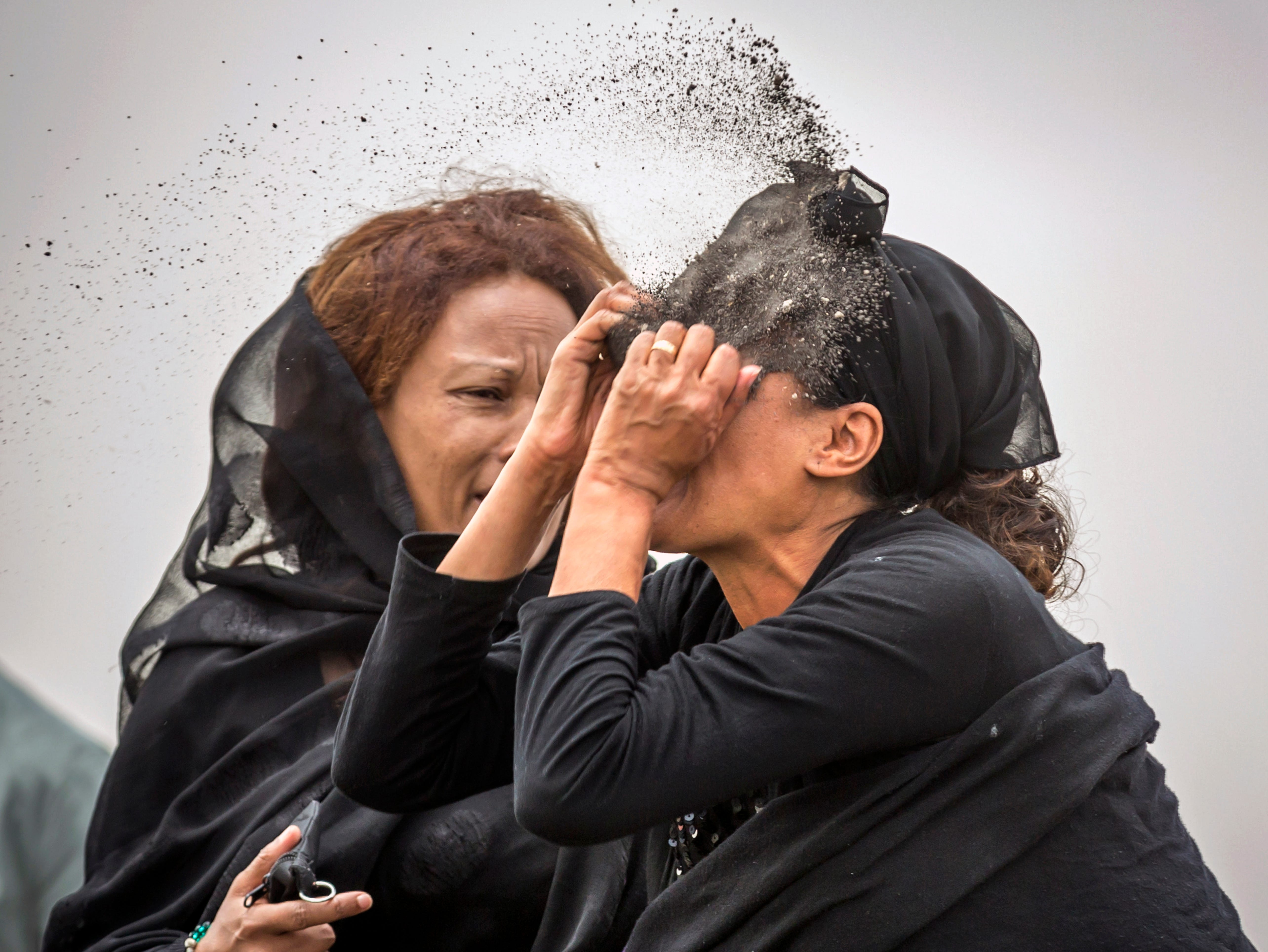 An Ethiopian relative of a crash victim throws dirt in her own face after realizing that there is nothing physical left of her loved one, as she mourns at the scene where the Ethiopian Airlines Boeing 737 Max 8 crashed shortly after takeoff on Sunday killing all 157 on board, near Bishoftu, south-east of Addis Ababa, in Ethiopia Thursday, March 14, 2019. About 200 family members of people who died on the crashed jet stormed out of a briefing with Ethiopian Airlines officials in Addis Ababa on Thursday, complaining that the airline has not given them adequate information.