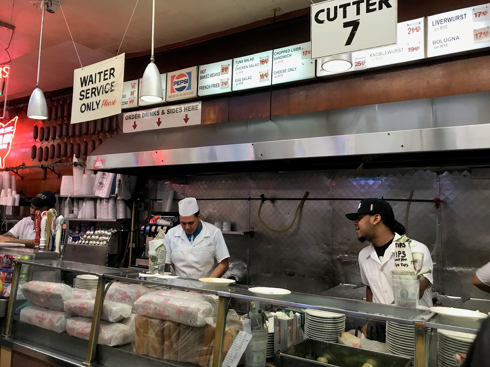 Most customers opt for self-serve, lining up at one of seven meat-cutting stations, with additional lines at the huge counter for everything else from hot dogs to sides to desserts.