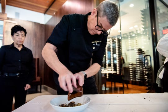 Chef Ken Frank, whose Napa restaurant La Toque often features truffles on the menu, is shown shaving truffles for the Winery Truffle Lunch at St. Supéry Estate Vineyards & Winery in Rutherford, California.