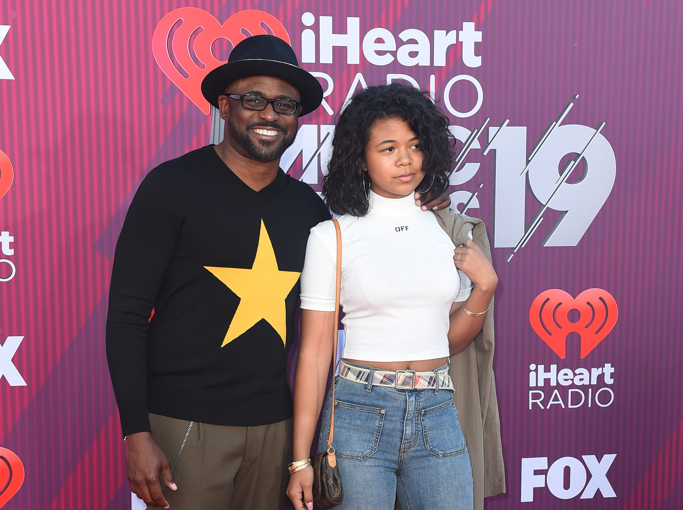 Wayne Brady, left, and his daughter Maile Masako Brady arrive at the iHeartRadio Music Awards.