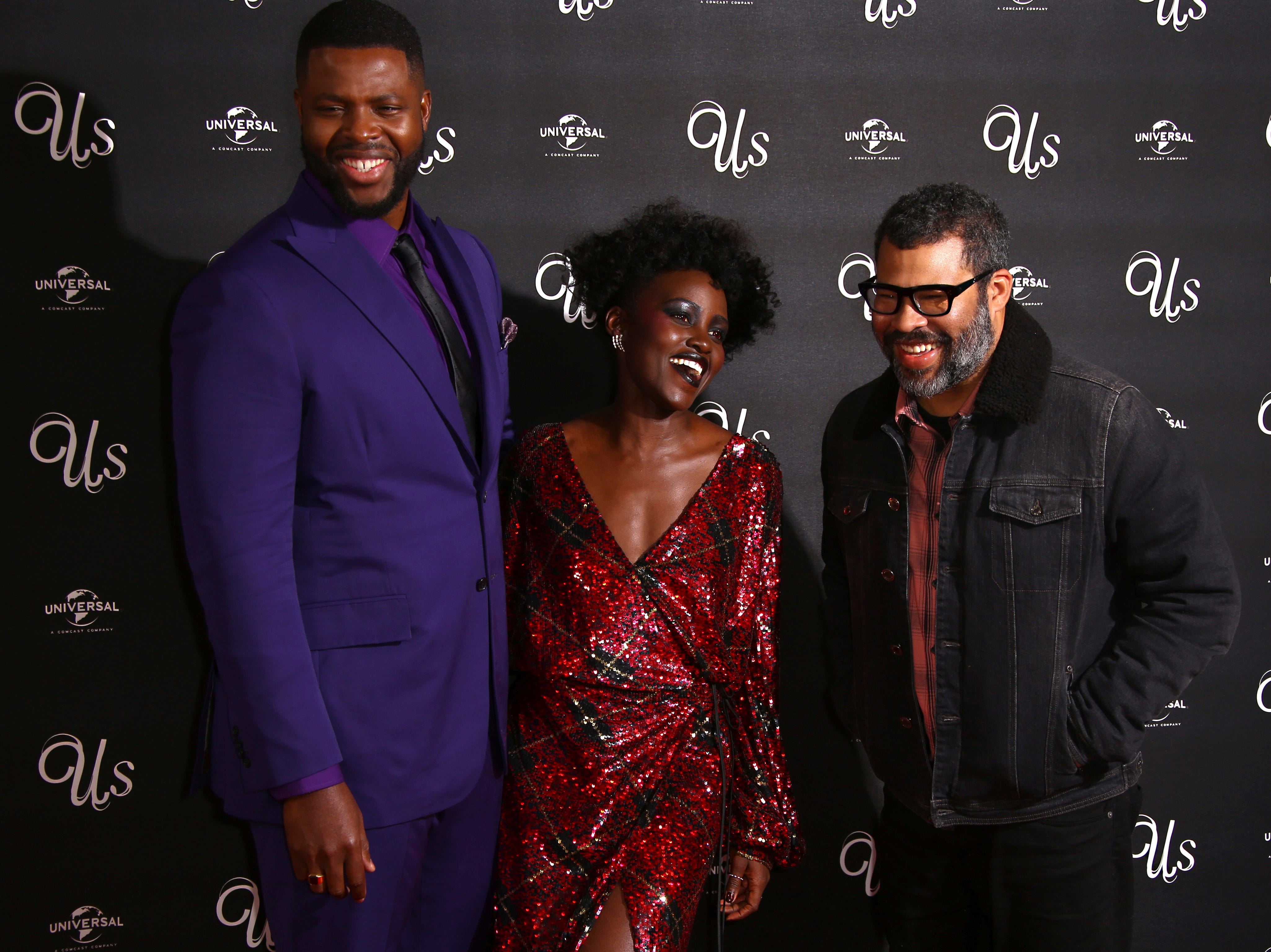 Actors Winston Duke, from left, Lupita Nyong'o and director Jordan Peele pose for photographers upon arrival at the premiere of the film 'Us' in London, Thursday, March 14, 2019. (Photo by Joel C Ryan/Invision/AP) ORG XMIT: LENT106