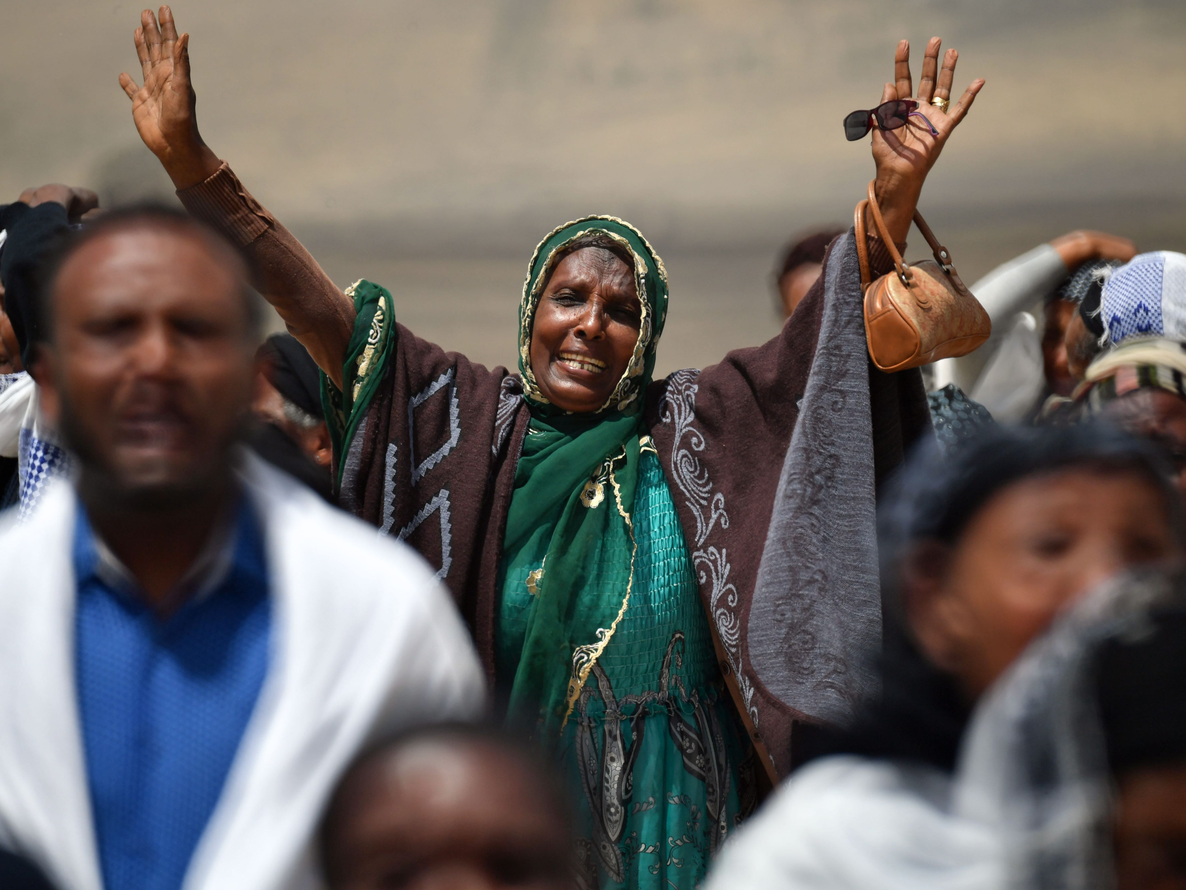 A distraught relative reacts as she arrives at the crash site of the Ethiopian Airlines operated Boeing 737 MAX aircraft, at Hama Quntushele village in Oromia region, on March 14, 2019.