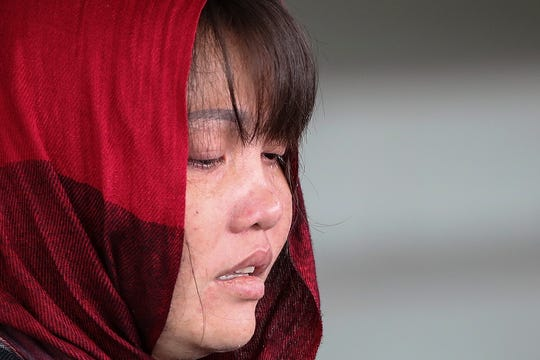 Vietnamese national Doan Thi Huong, who was detained in connection with the death of Kim Jong Nam, cries as she is escorted by Malaysian police officers leaving the Shah Alam High Court, Shah Alam, Malaysia, 14 March 2019. Doan Thi Huong from Vietnam charged with murder under Section 302 of the penal code, which carries mandatory death sentence if found guilty, pleaded not guilty during the murder trial.