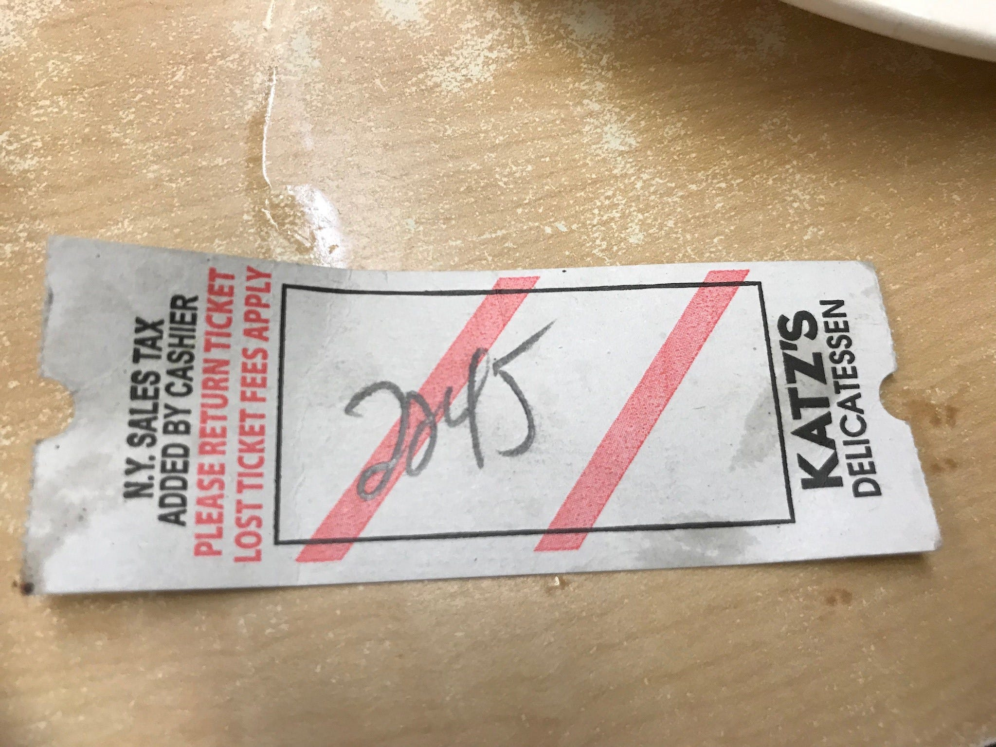 Every arriving customer gets a blank ticket, and servers write the tally of orders on it to be paid at the end.