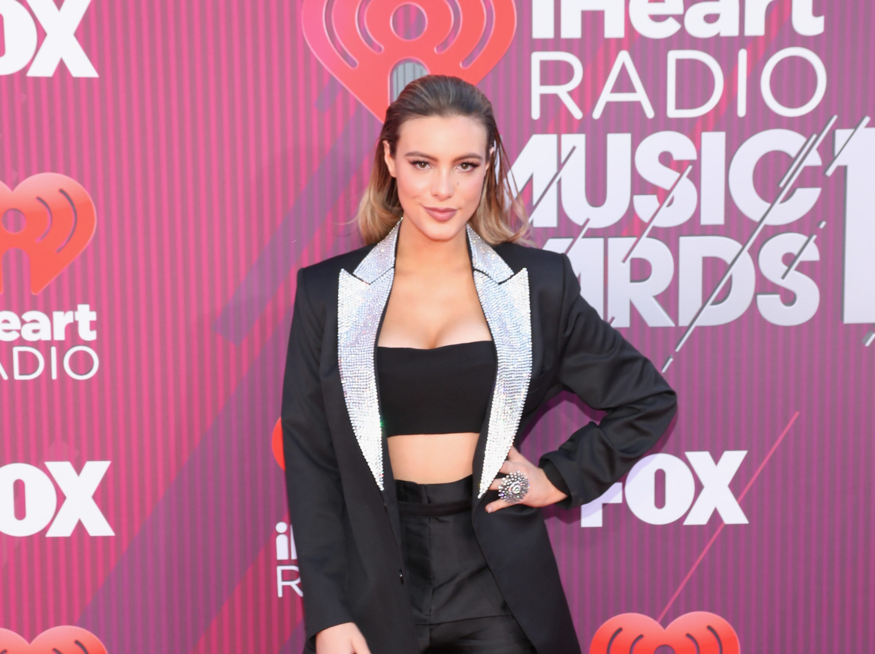 Lele Pons arrives at the iHeartRadio Music Awards.
