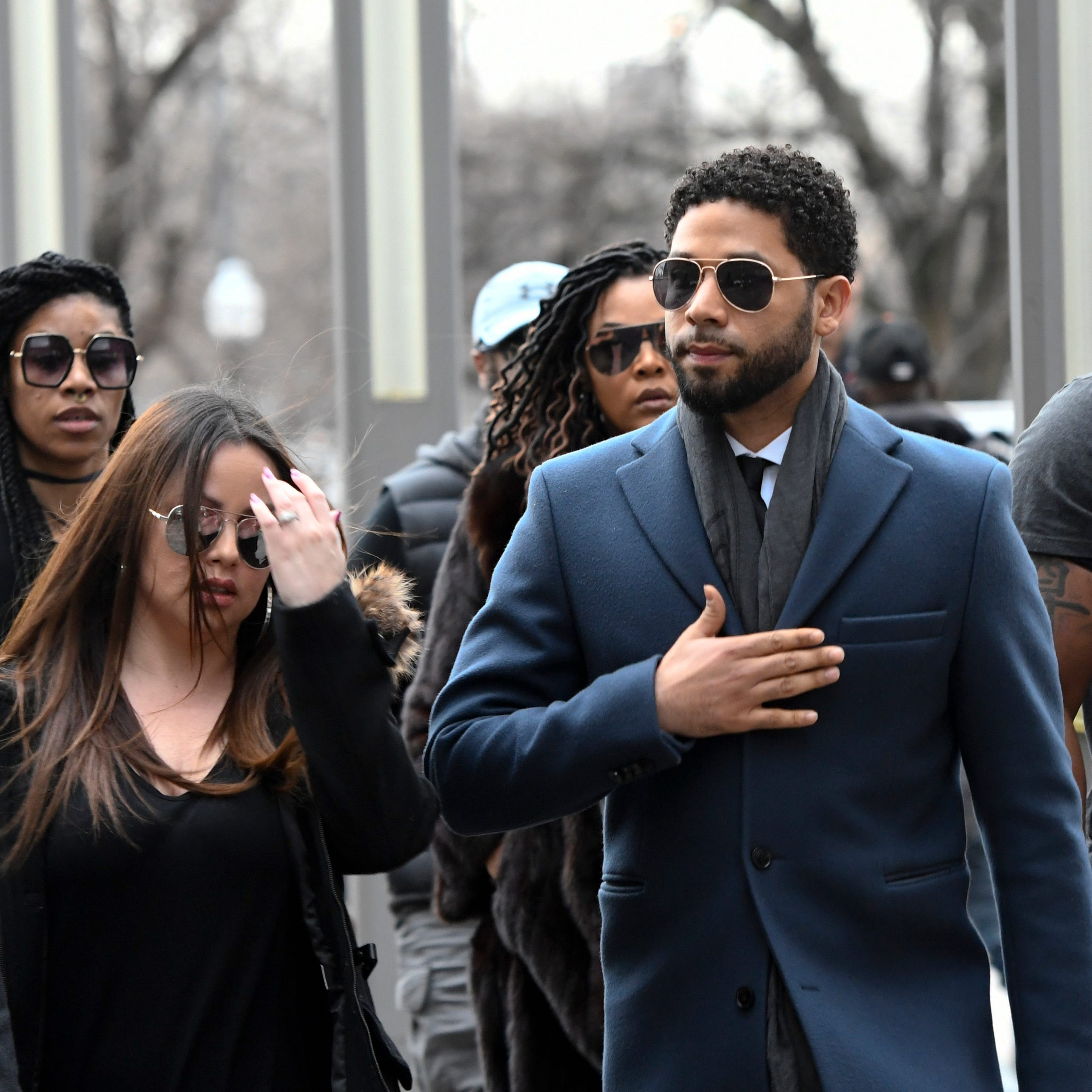 """Empire"" actor Jussie Smollett, center, arrives at Chicago's Leighton Criminal Court Building for his arraignment hearing on Thursday, March 14, 2019."