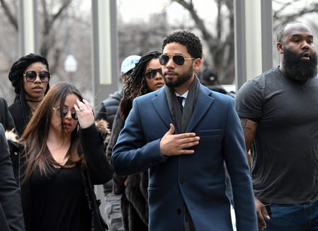 """""""Empire"""" actor Jussie Smollett, center, arrives at Chicago's Leighton Criminal Court Building for his arraignment hearing on Thursday, March 14, 2019."""