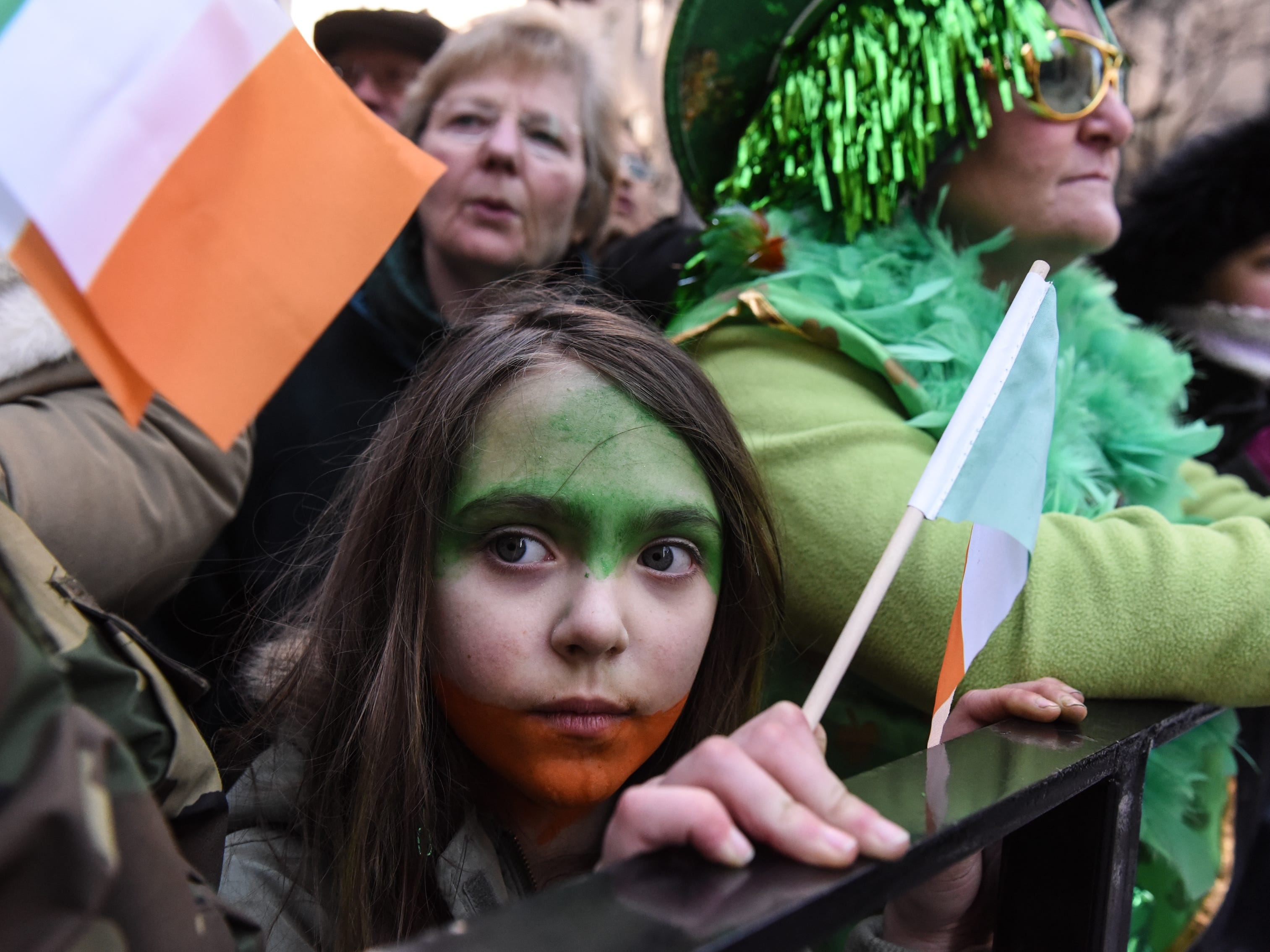 NEW YORK, NY - MARCH 17: People dress in Irish colors along the sidelines of the annual St. Patrick's Day parade along 5th Ave. on March 17, 2018 in New York City. New York's Saint Patrick's Day parade is the largest in the world. (Photo by Stephanie Keith/Getty Images) ORG XMIT: 775141848 ORIG FILE ID: 933083936