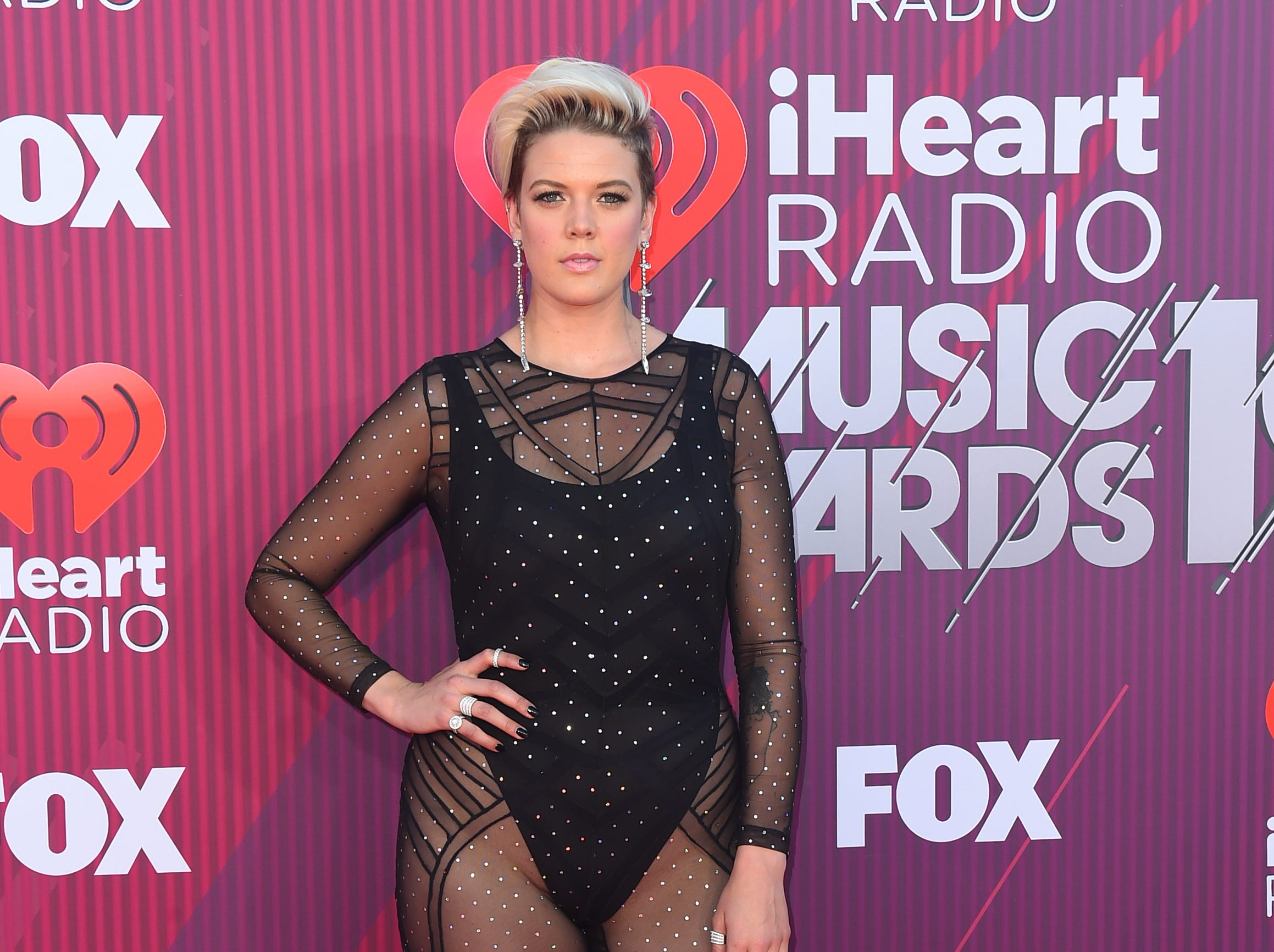 Betty Who arrives at the iHeartRadio Music Awards.