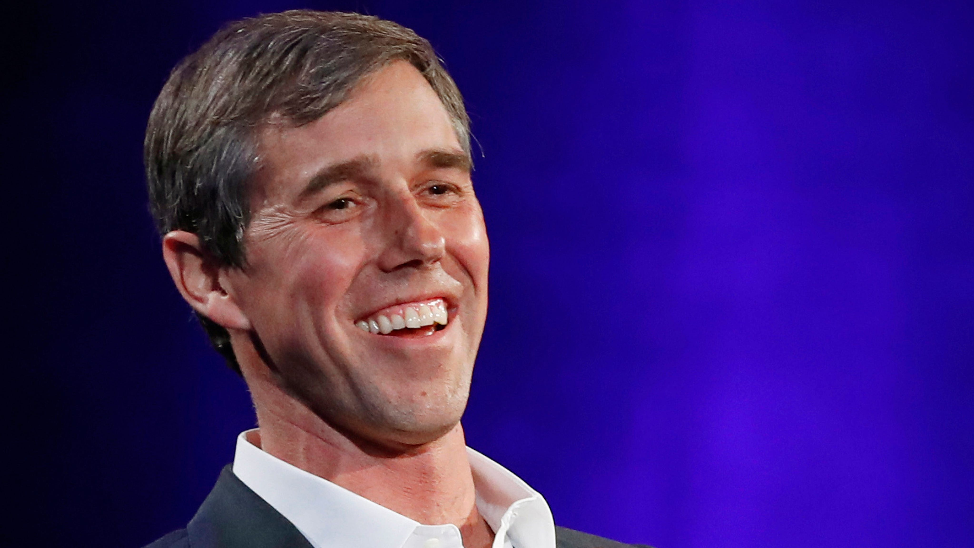 "Former Democratic Texas congressman Beto O'Rourke laughs during a live interview with Oprah Winfrey on a Times Square stage at ""SuperSoul Conversations,"" in New York, Feb.5, 2019."