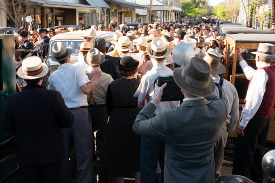 "The mob scene outside of Arcadia, Louisiana, as depicted in ""The Highwaymen."""