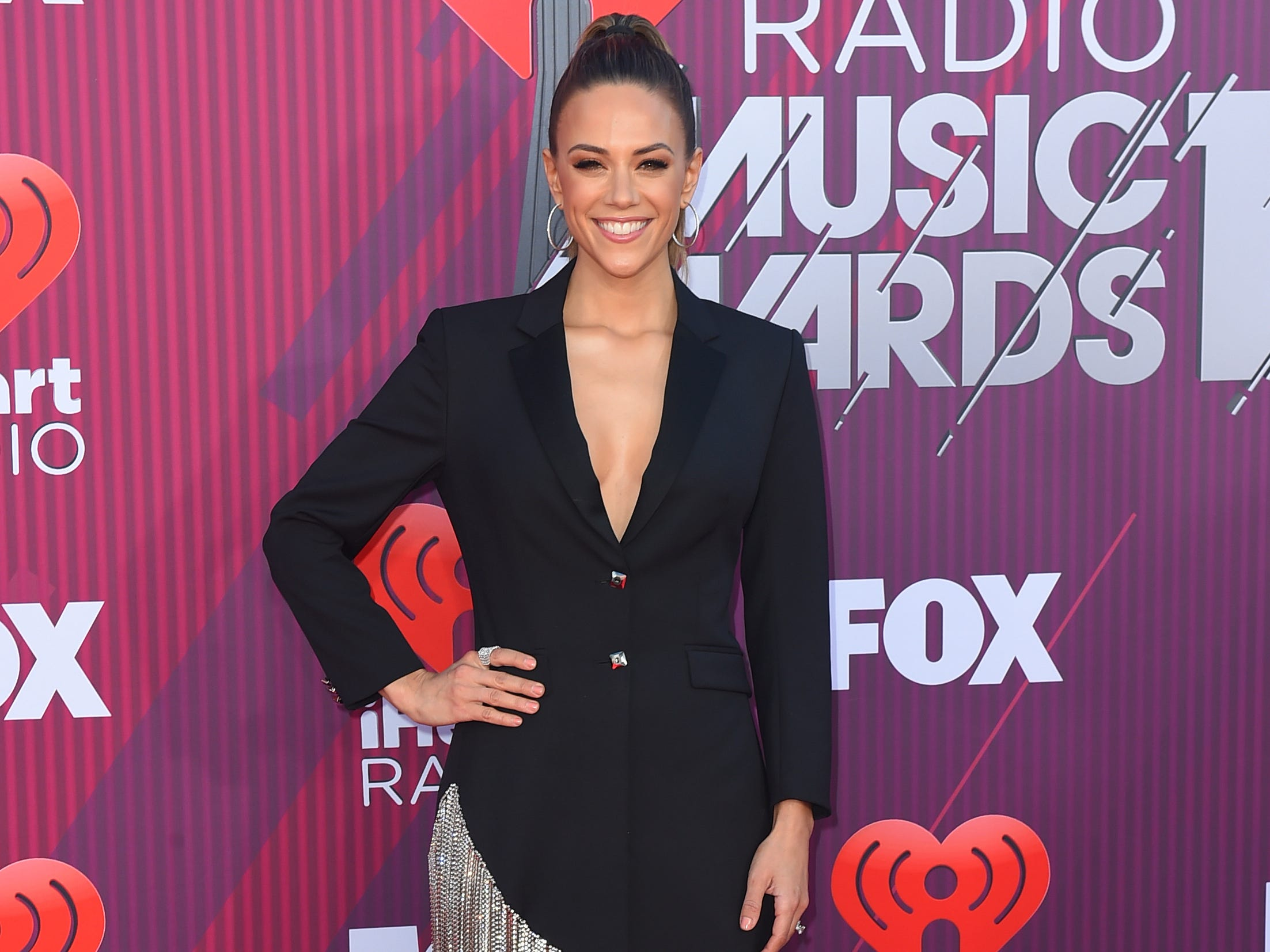 Jana Kramer arrives at the iHeartRadio Music Awards.
