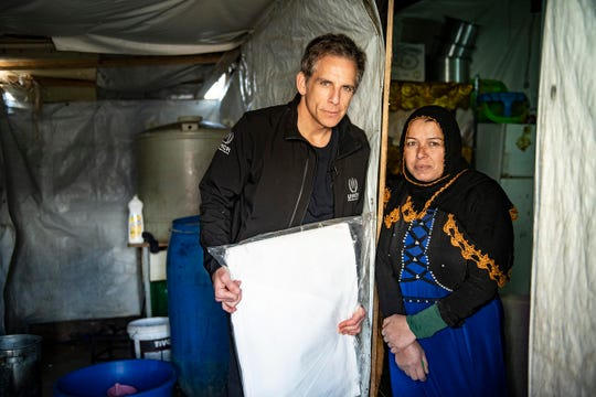 UNHCR Goodwill Ambassador Ben Stiller visiting an informal settlement in the Bekaa Valley, Lebanon, standing with a Syrian refugee.