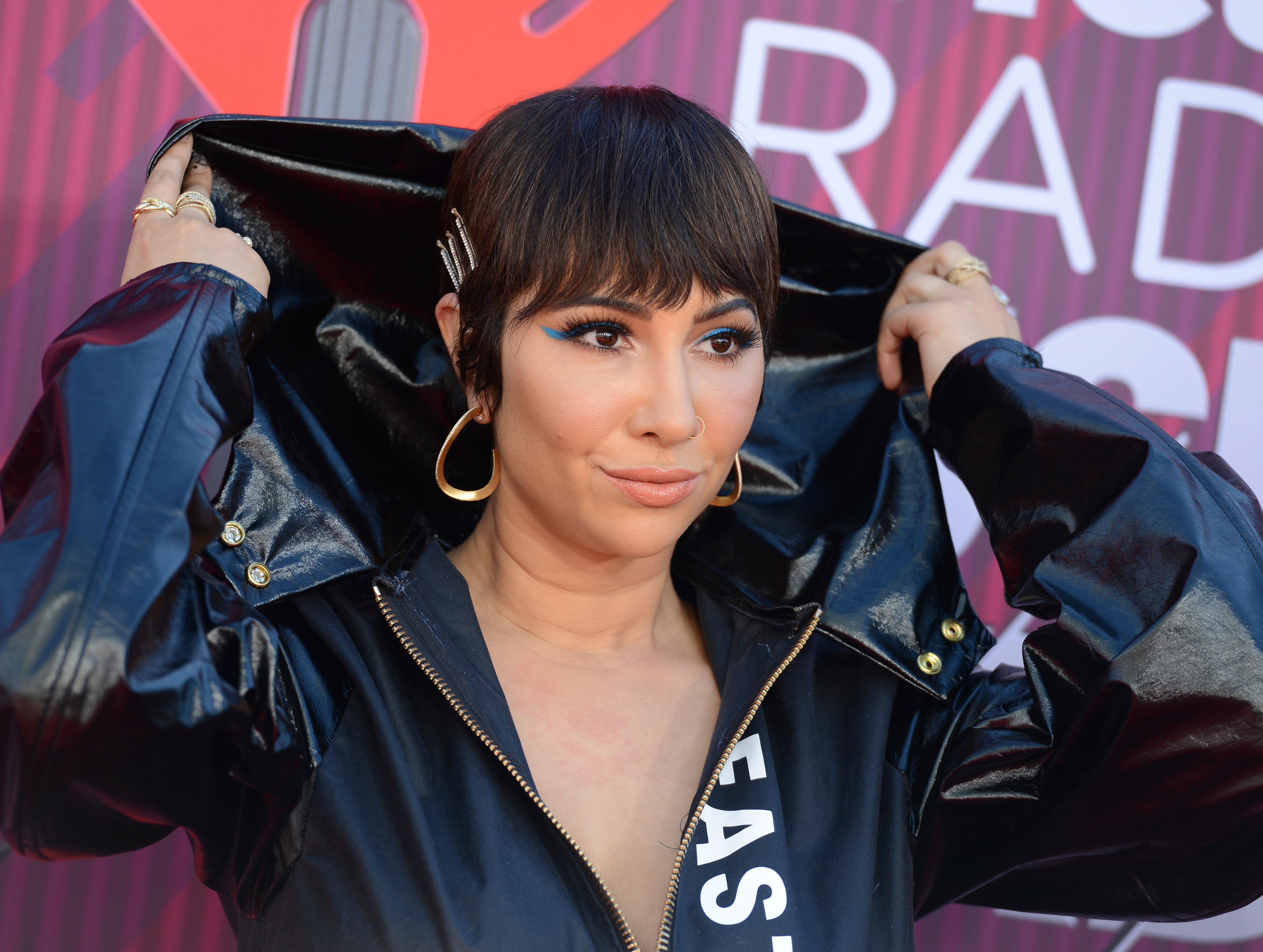 Jackie Cruz arrives at the iHeartRadio Music Awards.