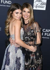 Lori Loughlin and Olivia Jade Giannulli at a 2018 party.