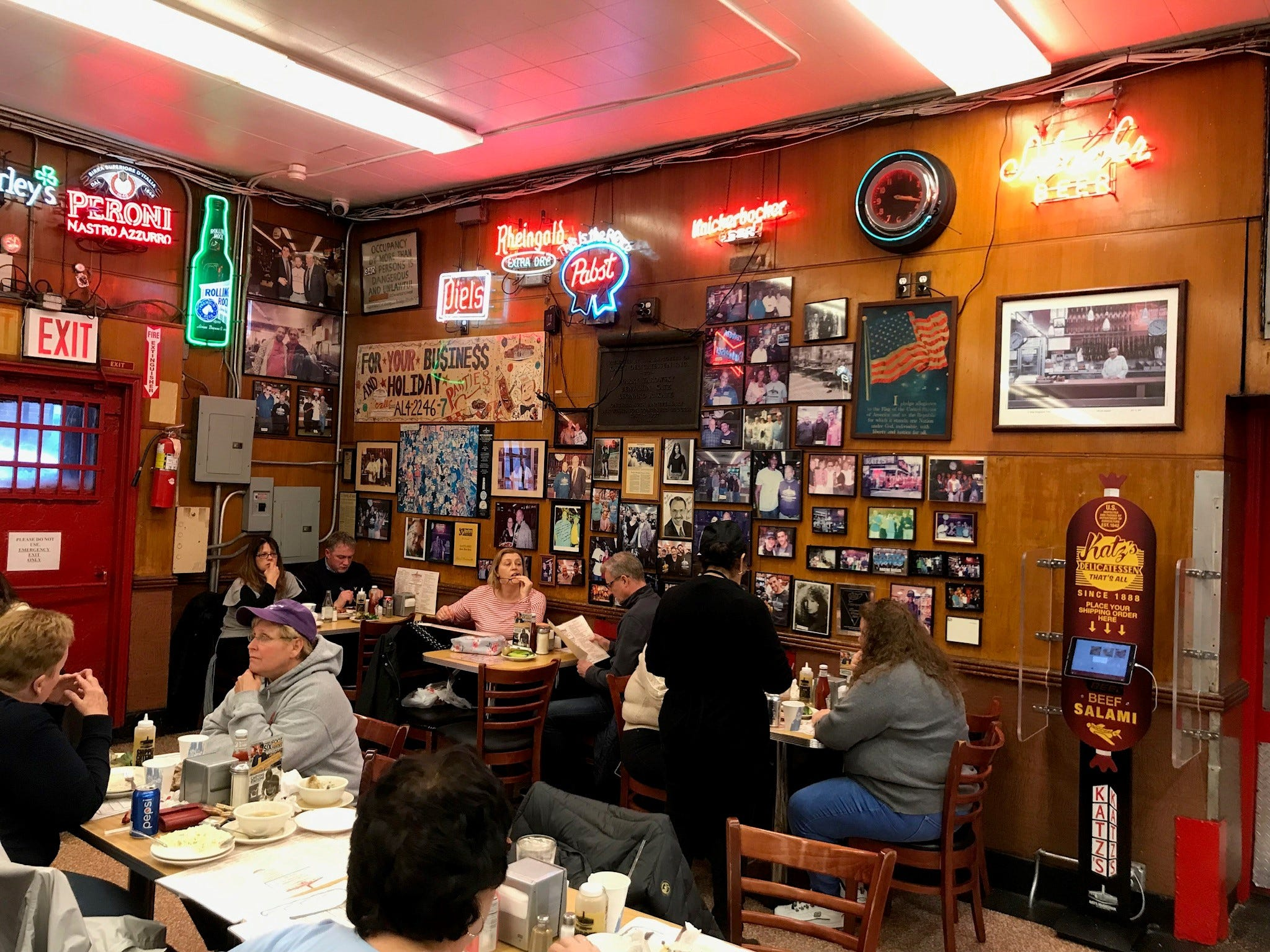 One corner of frenetic Katz's Deli, jammed with neon ads, old posters and framed photos.
