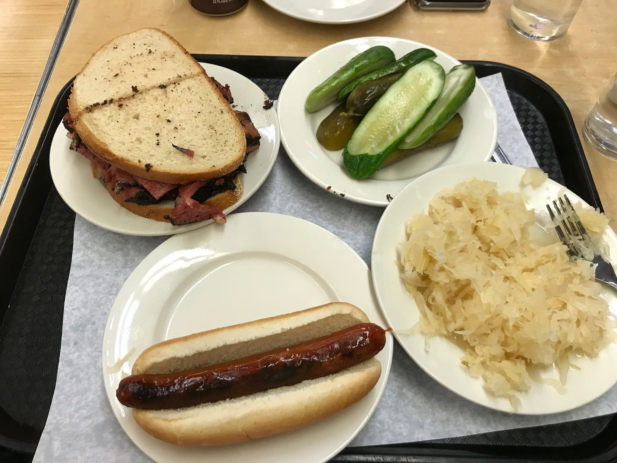 There is a lot of sharing and mix-and-match at Katz's. This tray features an all-beef hot dog, sauerkraut, house-cured pickles and a corned beef sandwich.