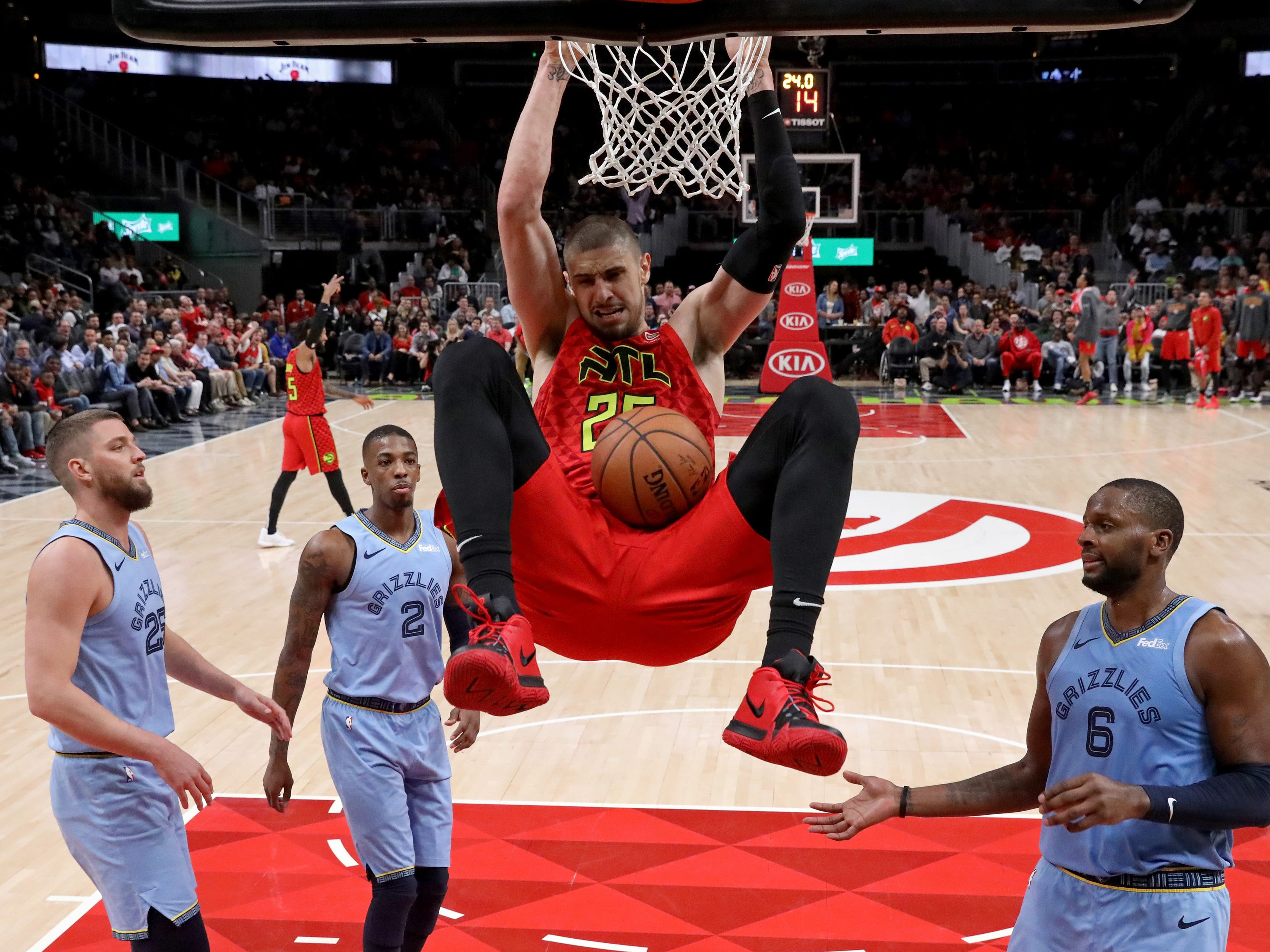 March 13: Atlanta Hawks center Alex Len dunks in the second half against the Memphis Grizzlies at State Farm Arena.