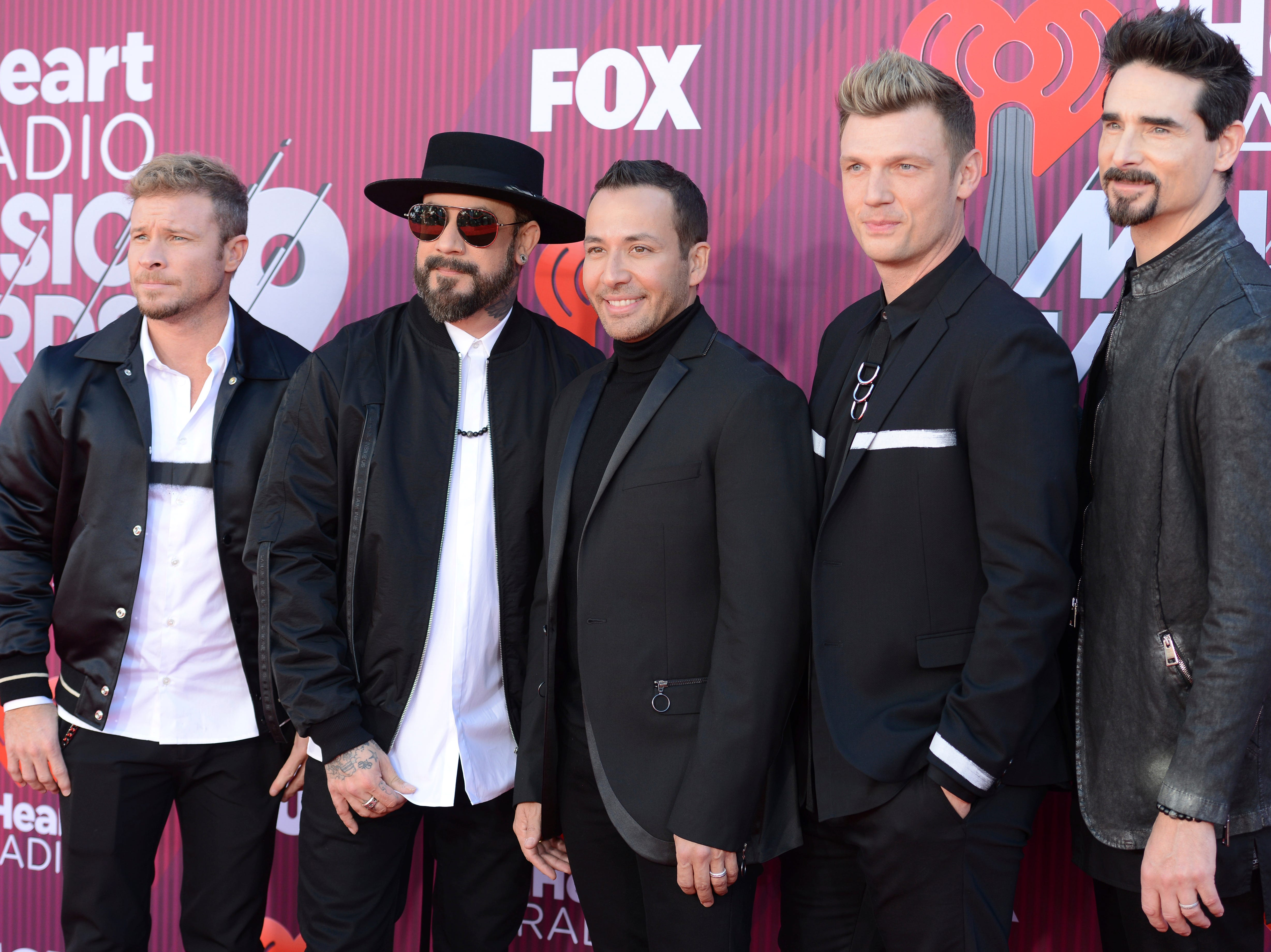 Brian Littrell, from left, AJ McLean, Howie Dorough, Nick Carter and Kevin Richardson of the Backstreet Boys, arrive at the iHeartRadio Music Awards.