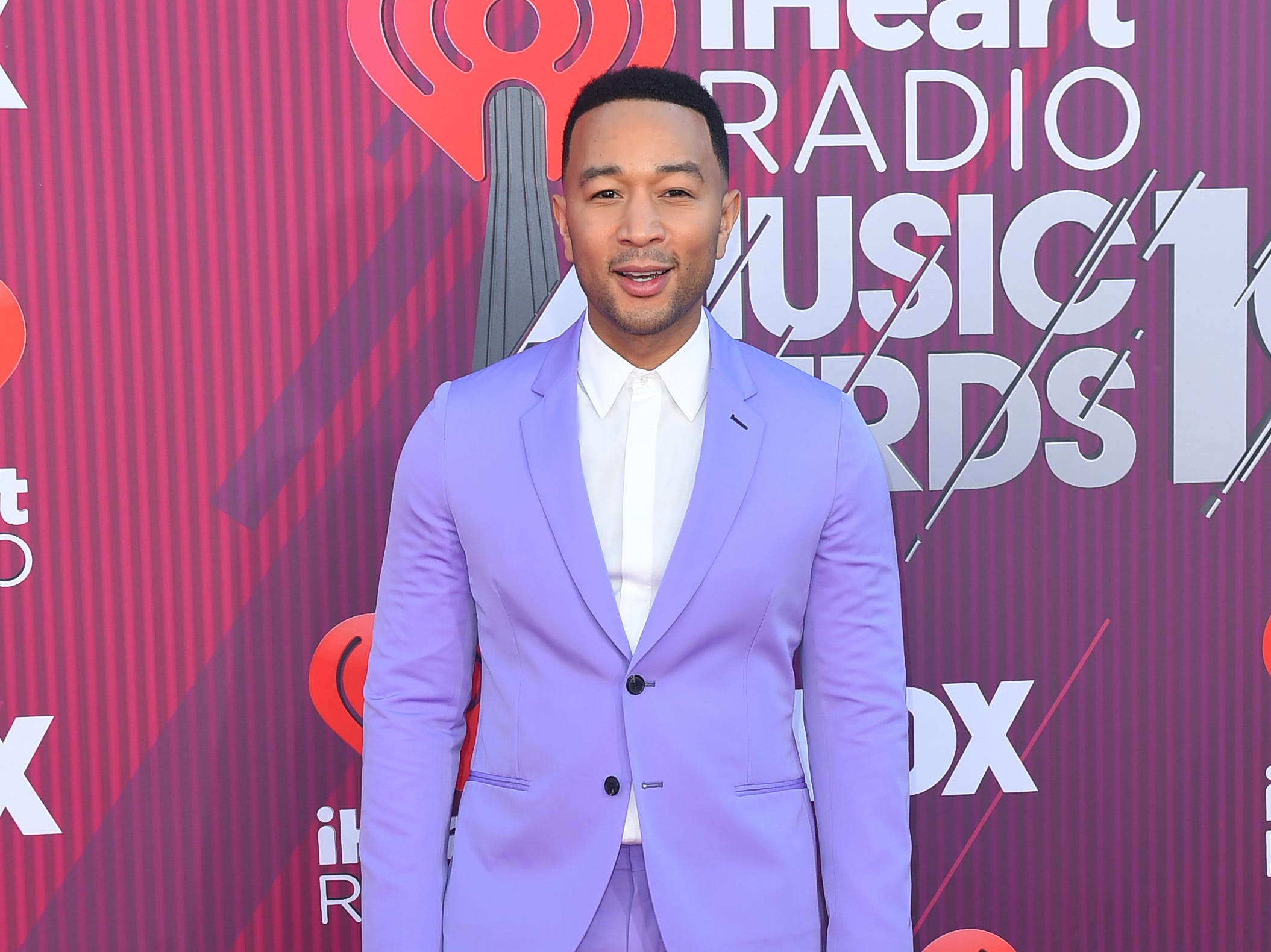John Legend arrives at the iHeartRadio Music Awards.