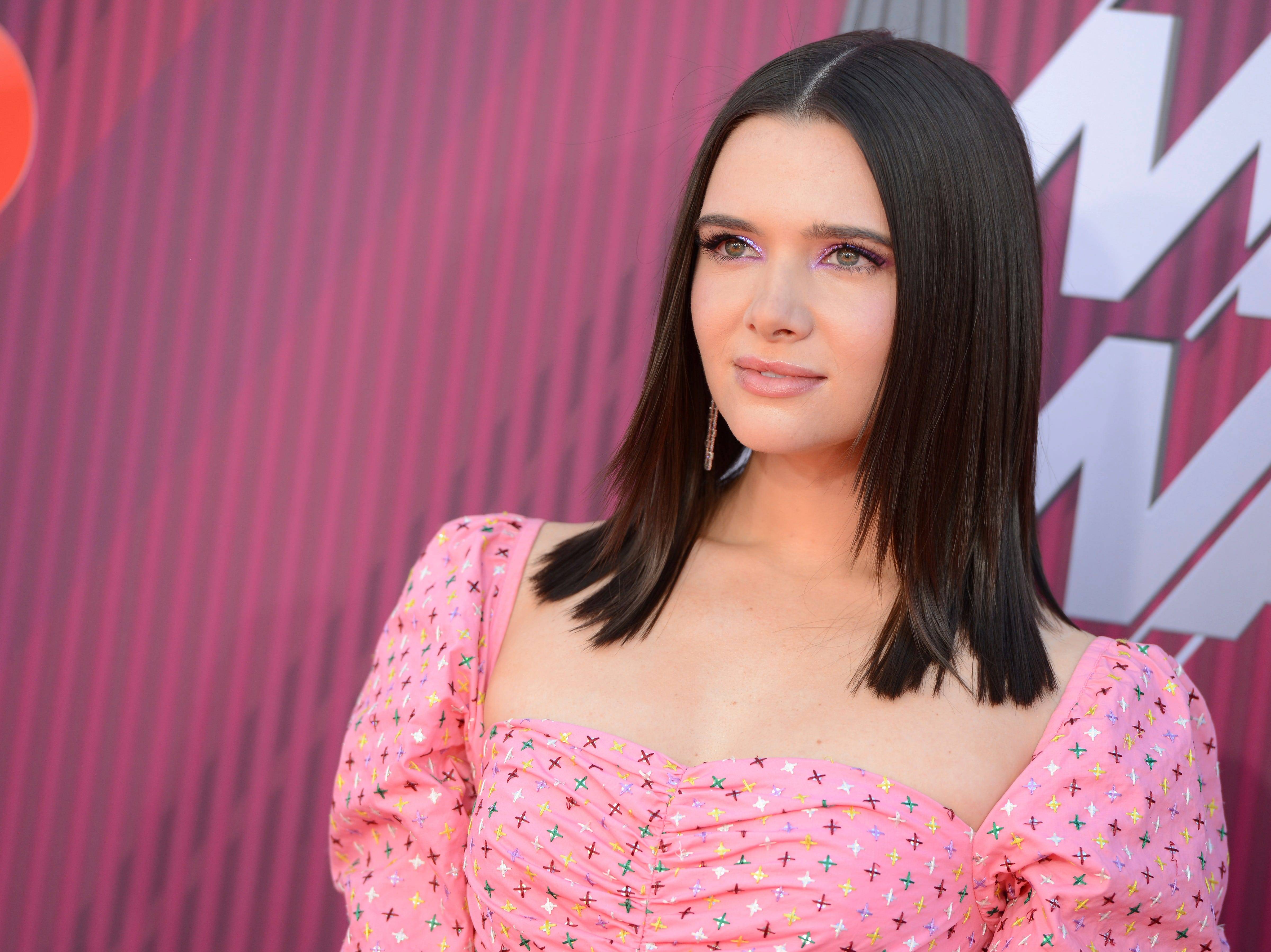 Katie Stevens arrives at the iHeartRadio Music Awards.