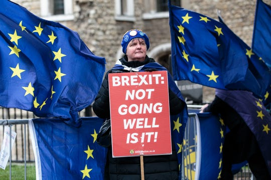 Anti-Brexit protesters demonstrate outside the Houses of Parliament on March 13 in London.