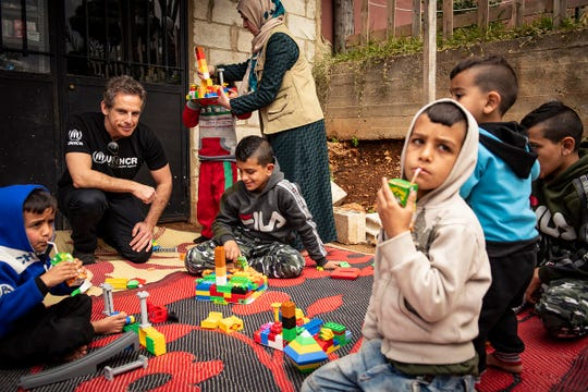 Ben Stiller with children at Zouq Bhannine informal settlement in Lebanon in March 2019.