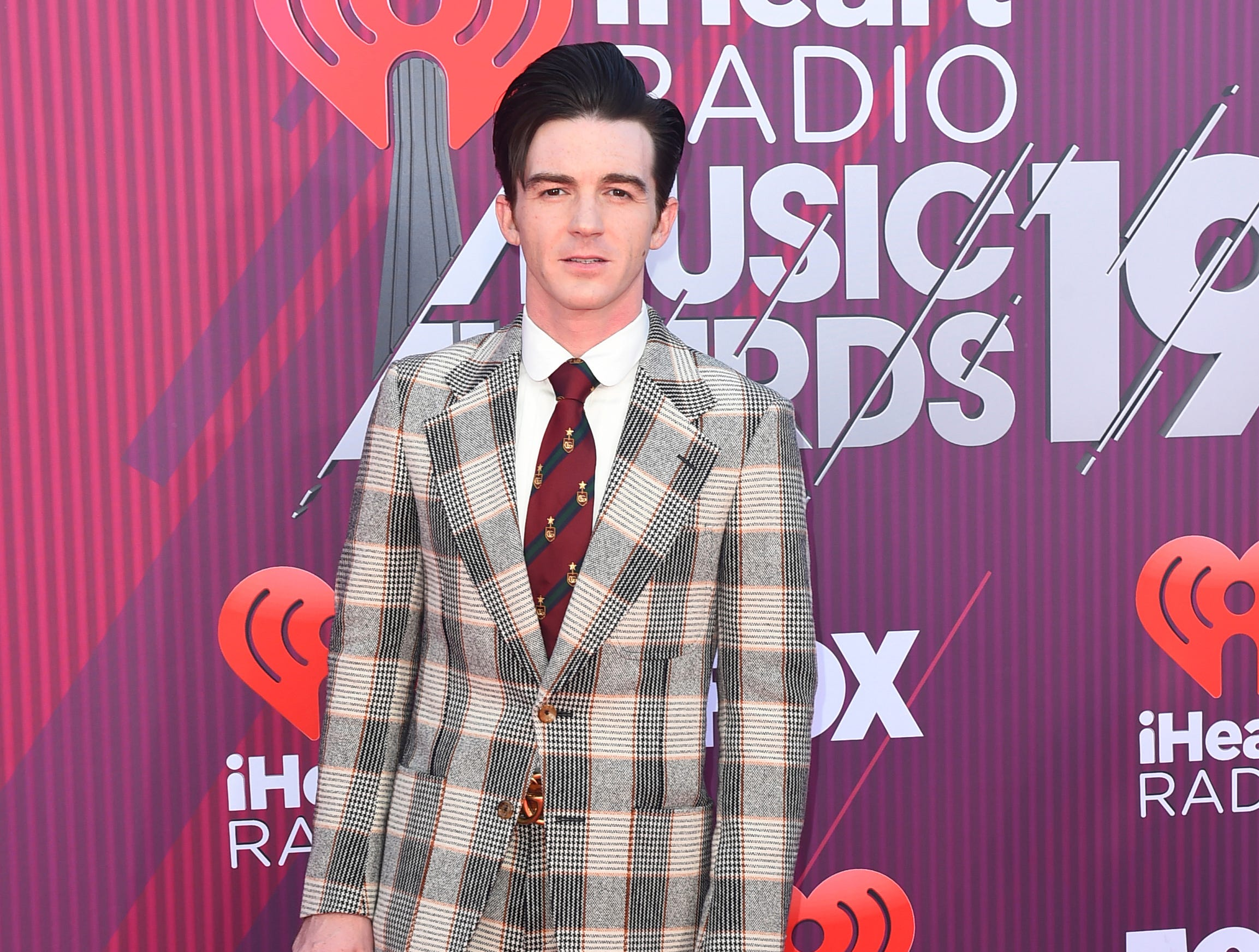 Drake Bell arrives at the iHeartRadio Music Awards.