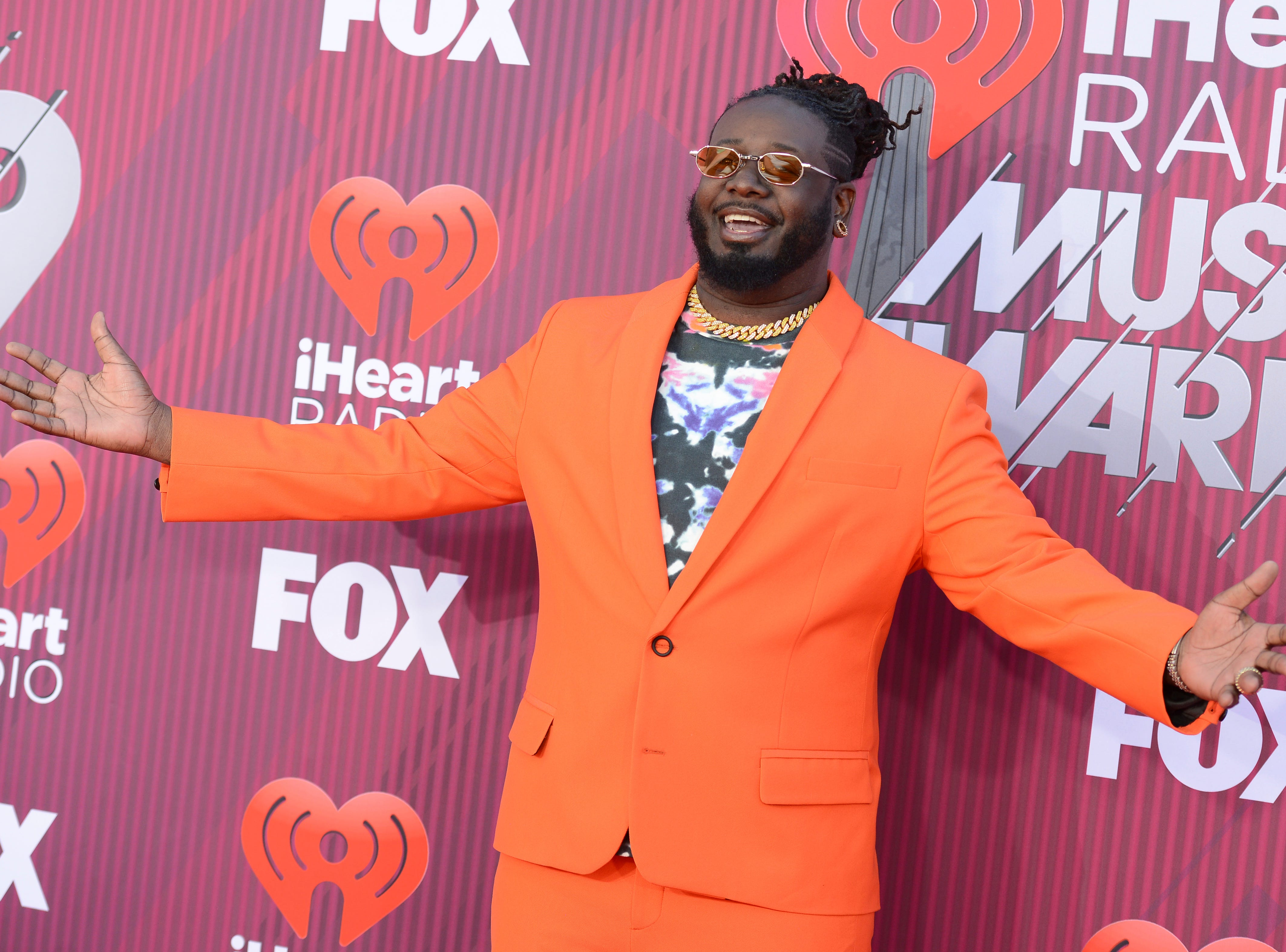 T-Pain arrives at the iHeartRadio Music Awards.