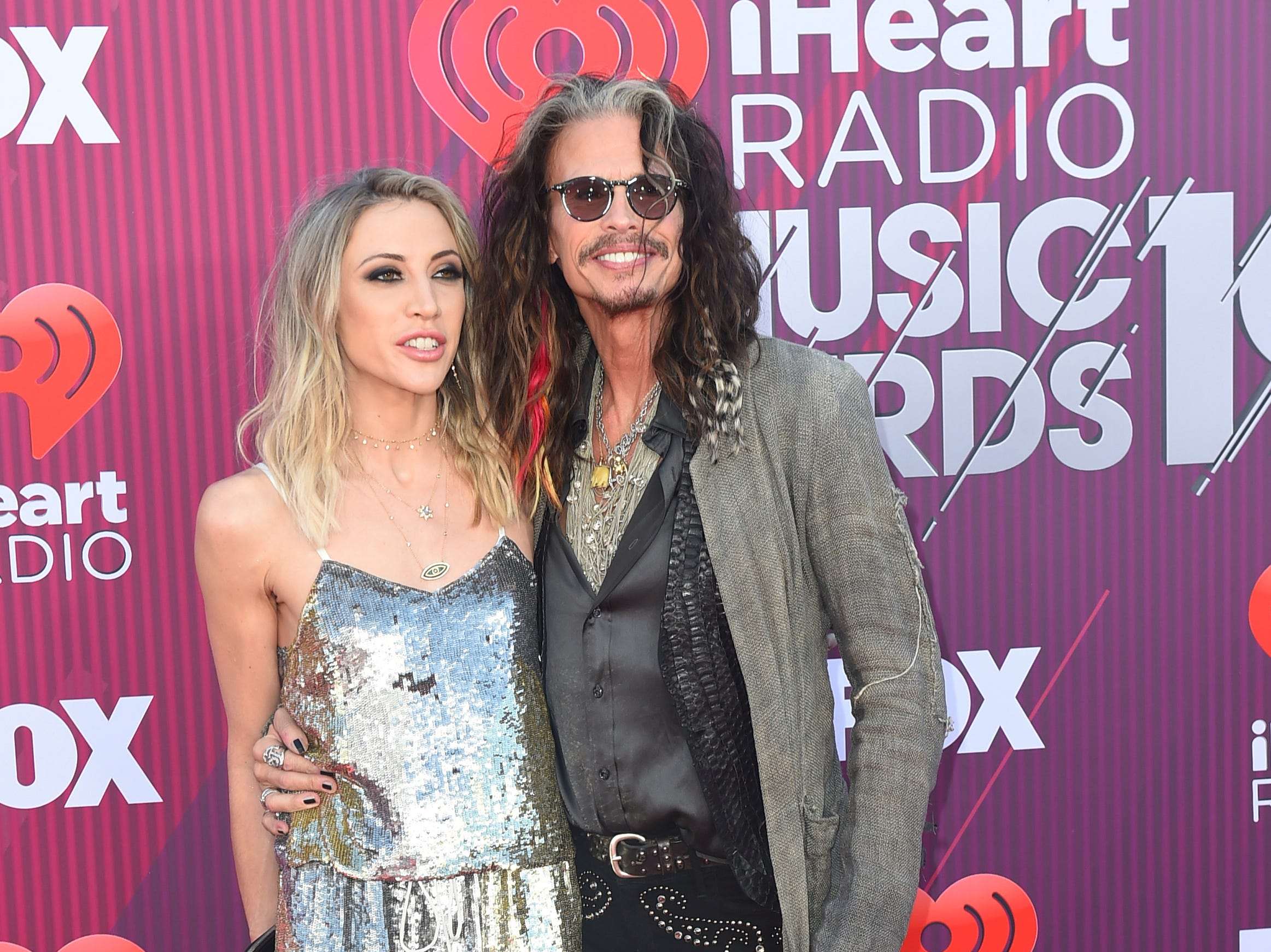 Steven Tyler and Aimee Preston arrive at the iHeartRadio Music Awards.