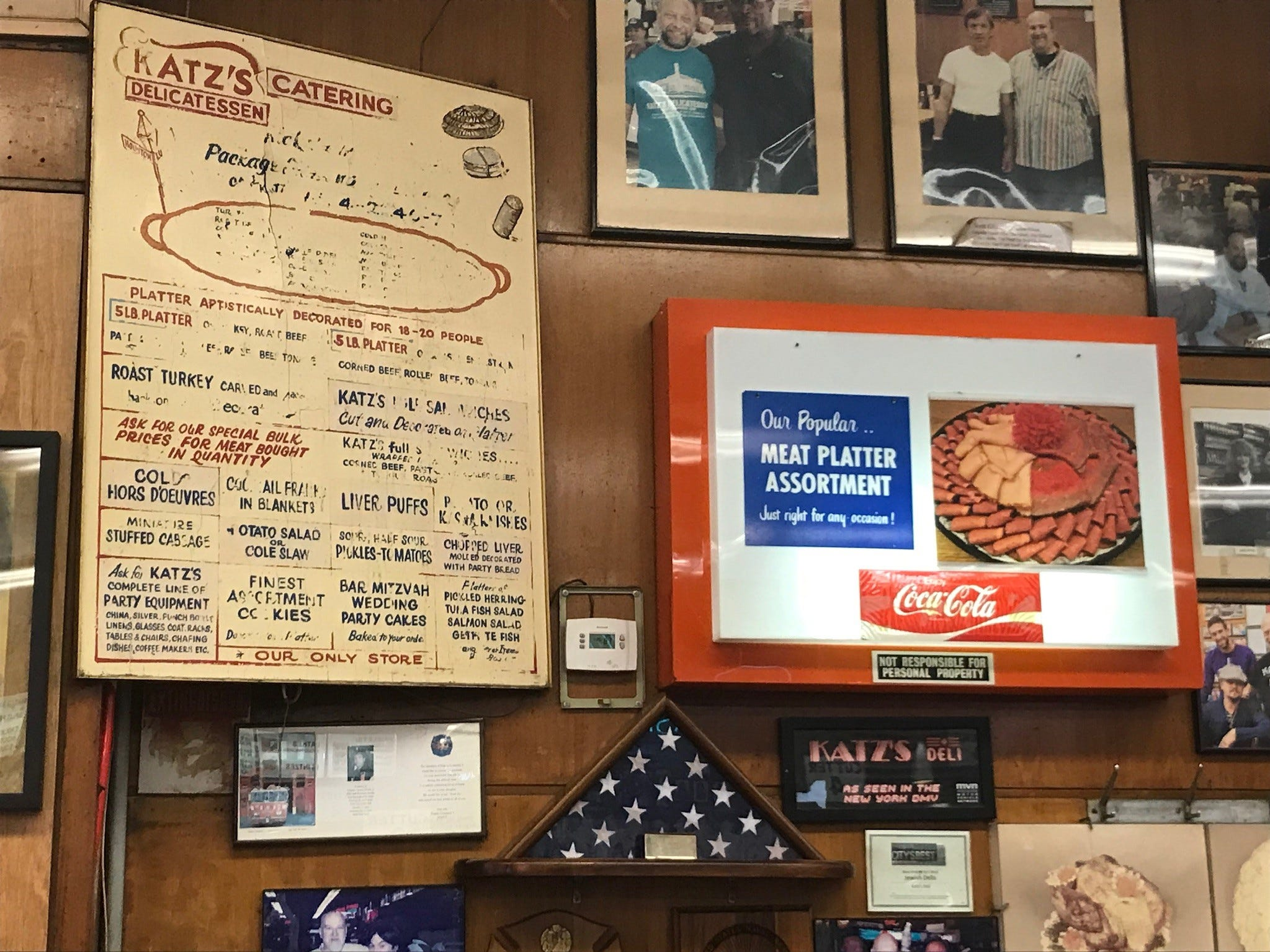 Katz's is big, but just about every inch of wall space is covered with photos, mementos or signs, some of which have been up for so long as to be unreadable.