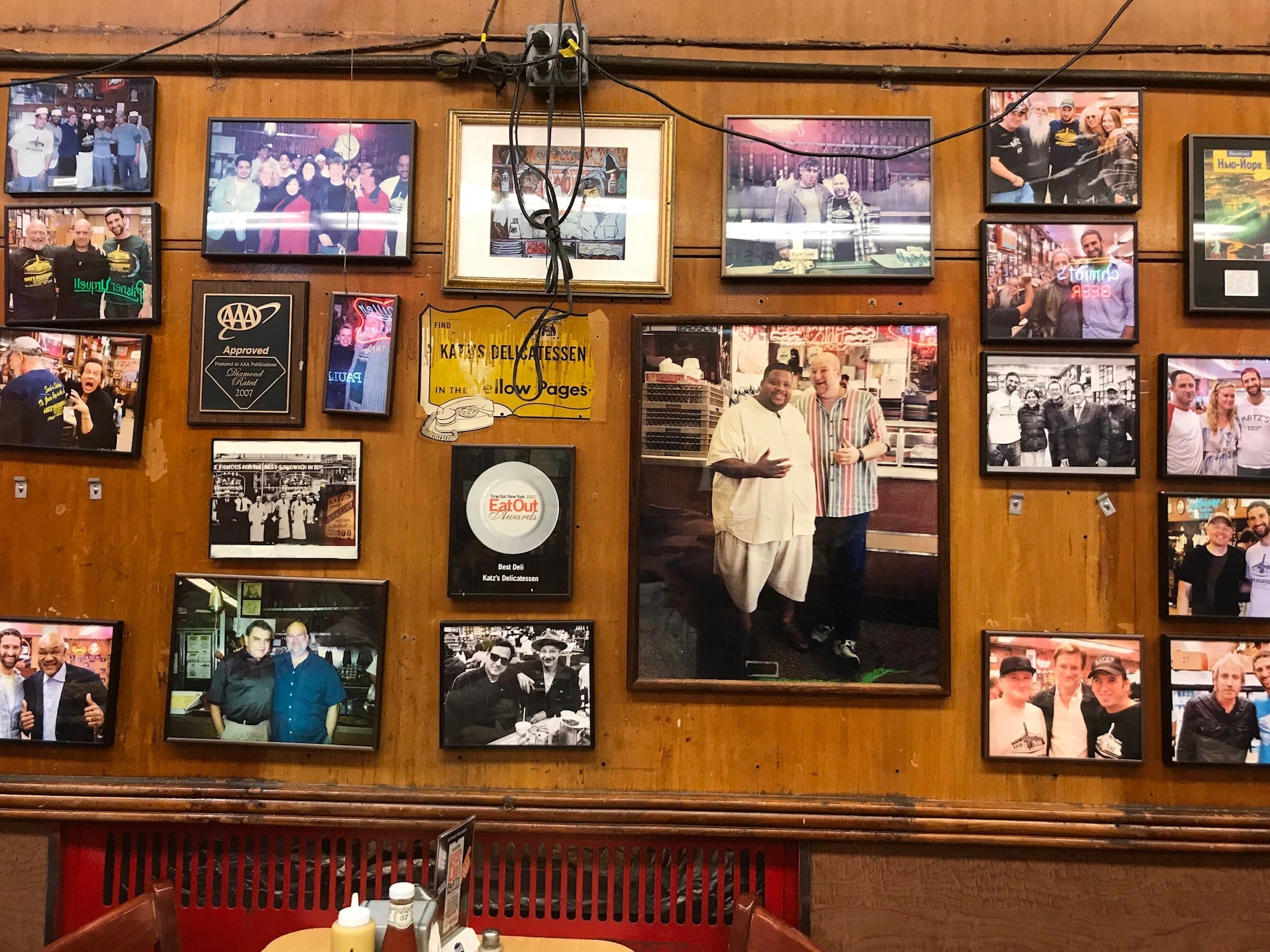 Some of the framed photos are of beloved New York celebrities, but many are unrecognizable, and part of the fun is trying to figure it all out (Billy Crystal is here someplace ... ).