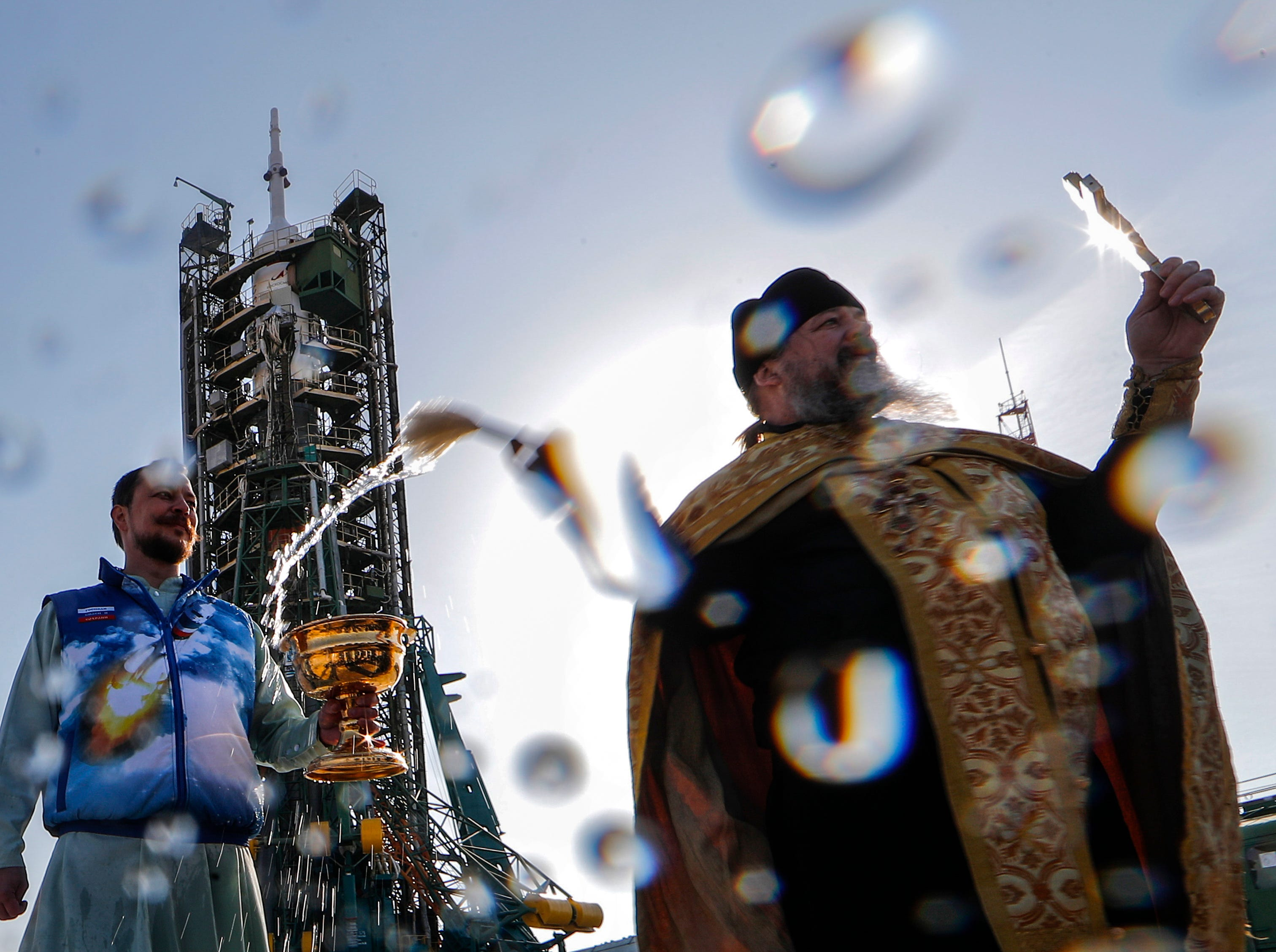 An Orthodox priest blesses the Russian Soyuz MS-12 spacecraft on the launch pad at the Baikonur Cosmodrome, Kazakhstan, 14 March 2019. Russian cosmonaut Alexey Ovchinin, NASA astronauts Christina Koch and Nick Hague will launch March 14, 2019.