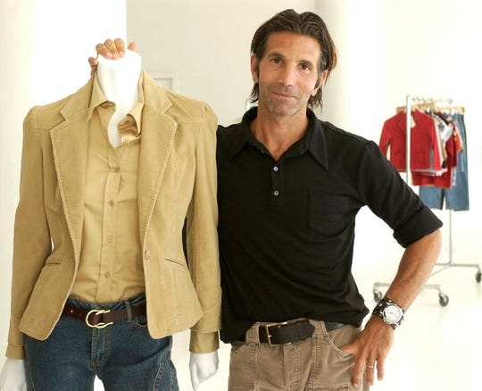 Clothing designer Mossimo Giannulli posing with his fall preview clothing for Target department stores in New York in 2002.
