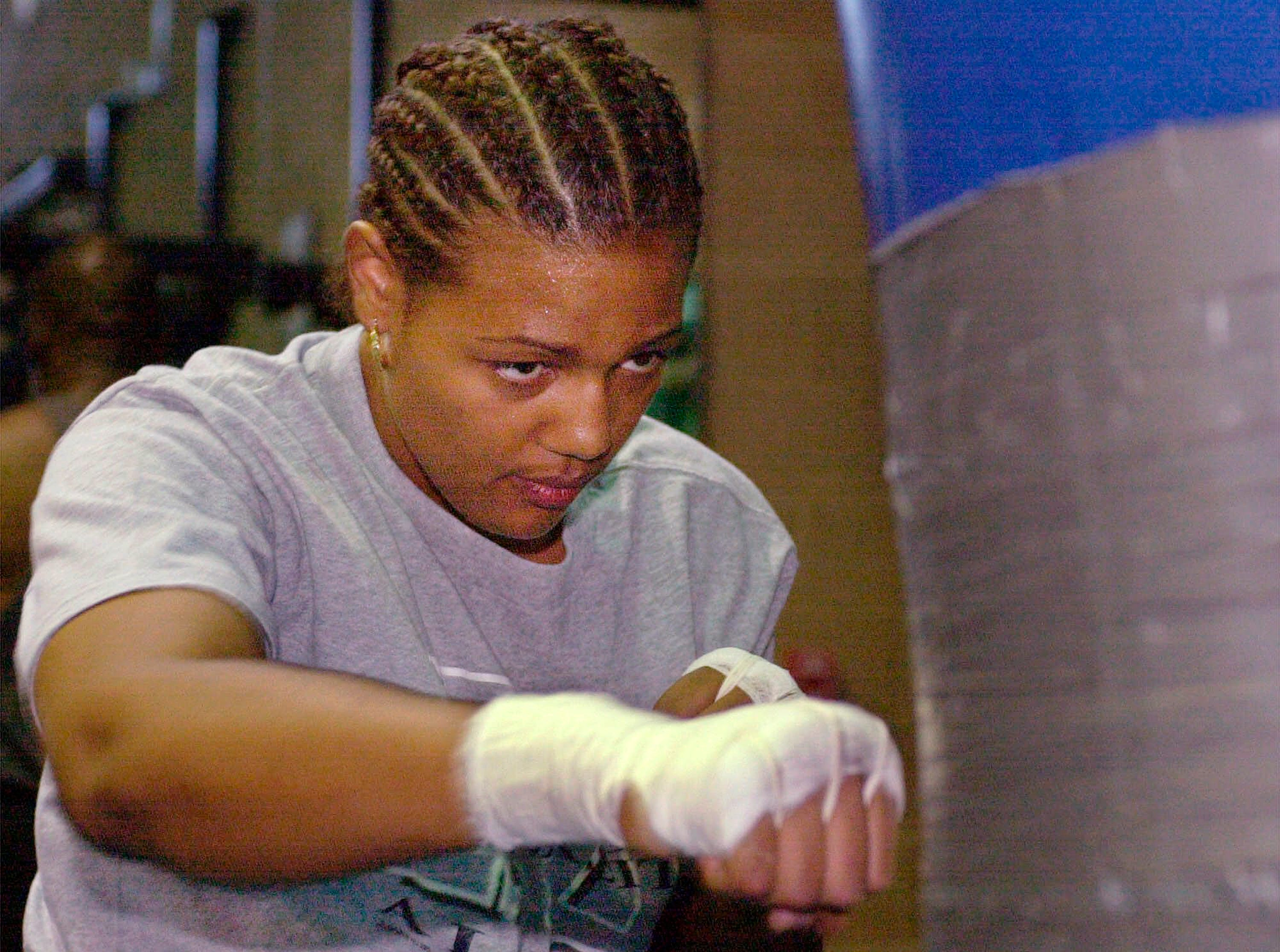 In this June 16, 2000, file photo, Freeda Foreman works out in a gym in Las Vegas. The 42-year-old daughter of former heavyweight champion George Foreman died at a Houston-area home. The Harris County sheriff's office said deputies were called Friday, March 8, 2019, to the home where EMS had determined Freeda George Foreman was dead.