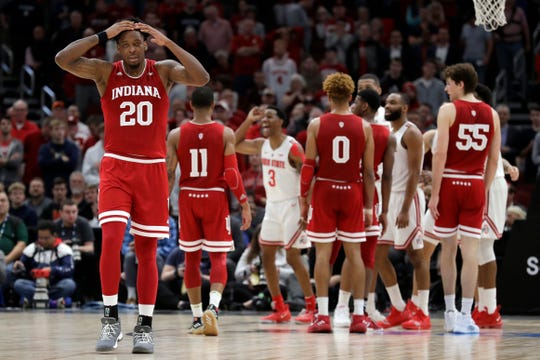Indiana's De'Ron Davis (20) reacts to an offensive foul call during the second half of an NCAA college basketball game against the Ohio State in the second round of the Big Ten Conference tournament, Thursday, March 14, 2019, in Chicago.