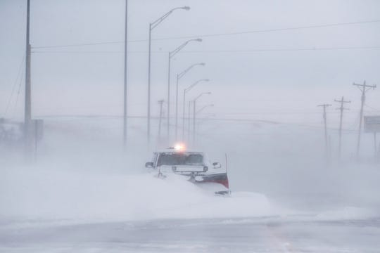 "This file photo shows a truck stuck in a snow drift in Rapid City, S.D., during a ""bomb cyclone' Thursday, March 14, 2019. Another major winter storm was cranking up in the Midwest on Wednesday."