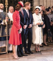 Duchess Kate of Cambridge talks with Duchess Meghan of Sussex, with husbands Prince William and Prince Harry, at the Commonwealth Day service at Westminster Abbey, March 11, 2019.