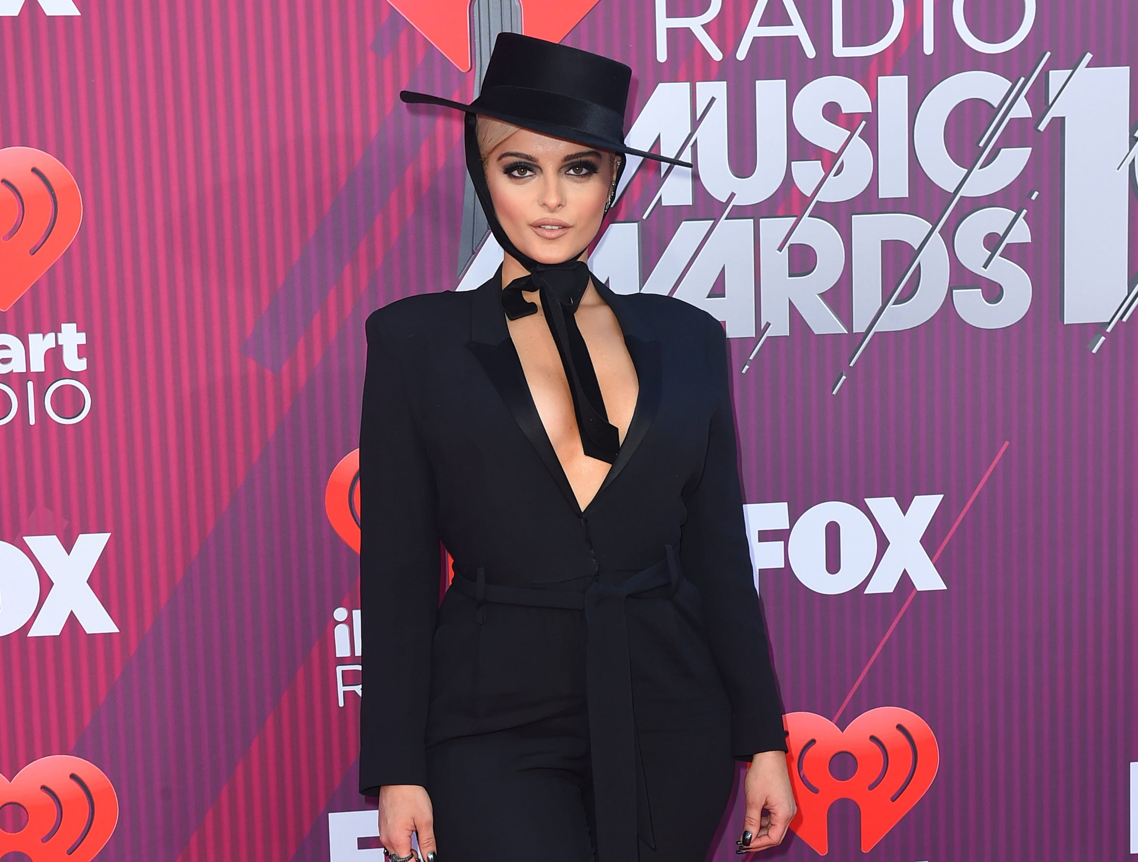 Bebe Rexha arrives at the iHeartRadio Music Awards.