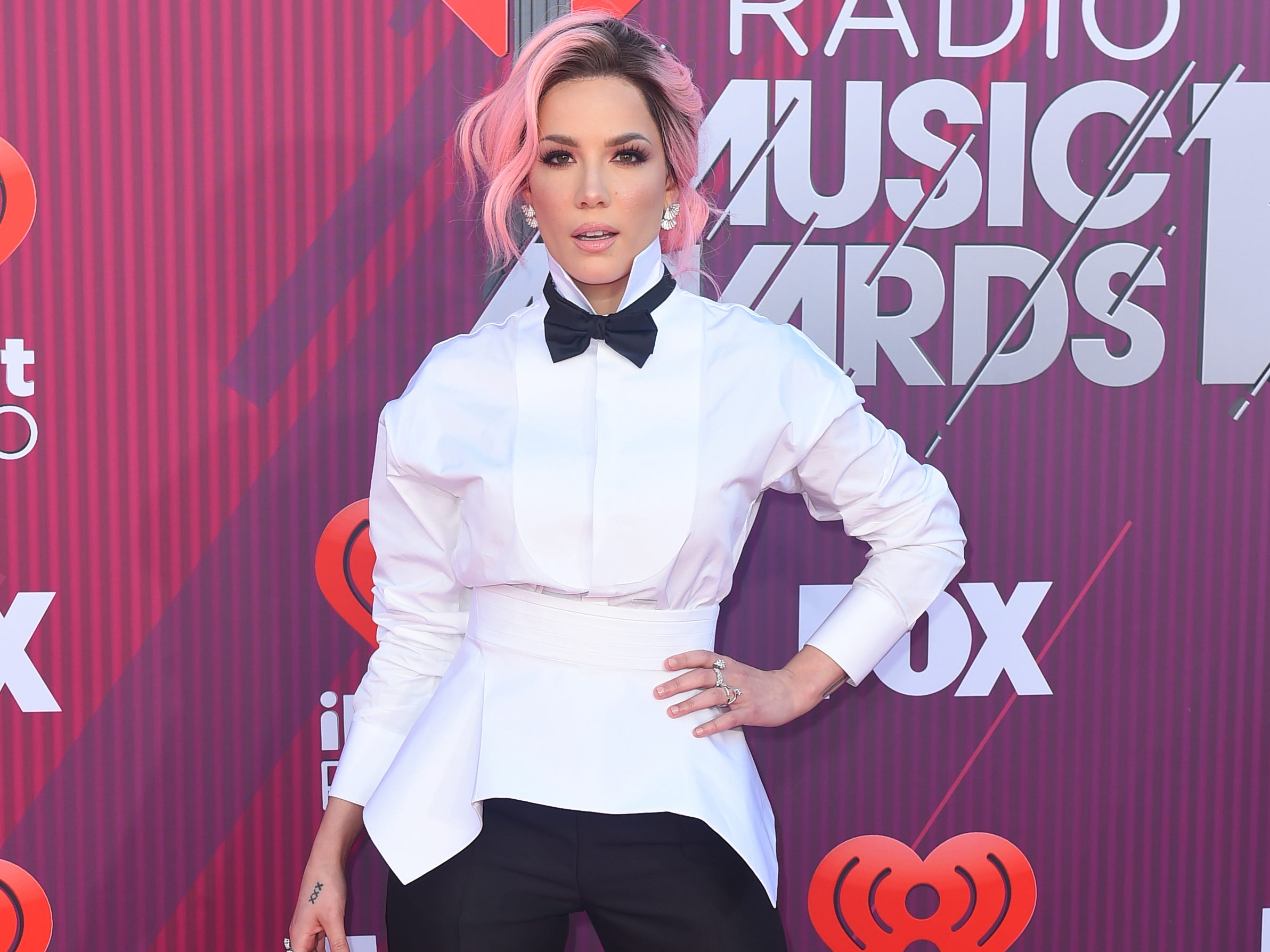 Halsey arrives at the iHeartRadio Music Awards.