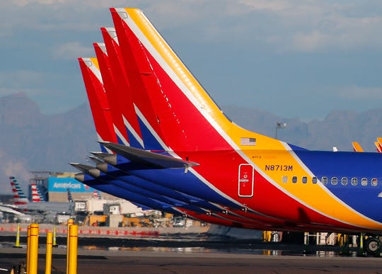A group of Southwest Airlines Boeing 737 MAX 8 aircraft sit on the tarmac at Phoenix Sky Harbor International Airport.