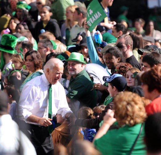 ORG XMIT: PAJH103 U.S. Vice President Joe Biden, bottom left, greets people as he walks in the annual St. Patrick's Day Parade in Pittsburgh, Pa., Saturday, March 17, 2012. (AP Photo/John Heller)