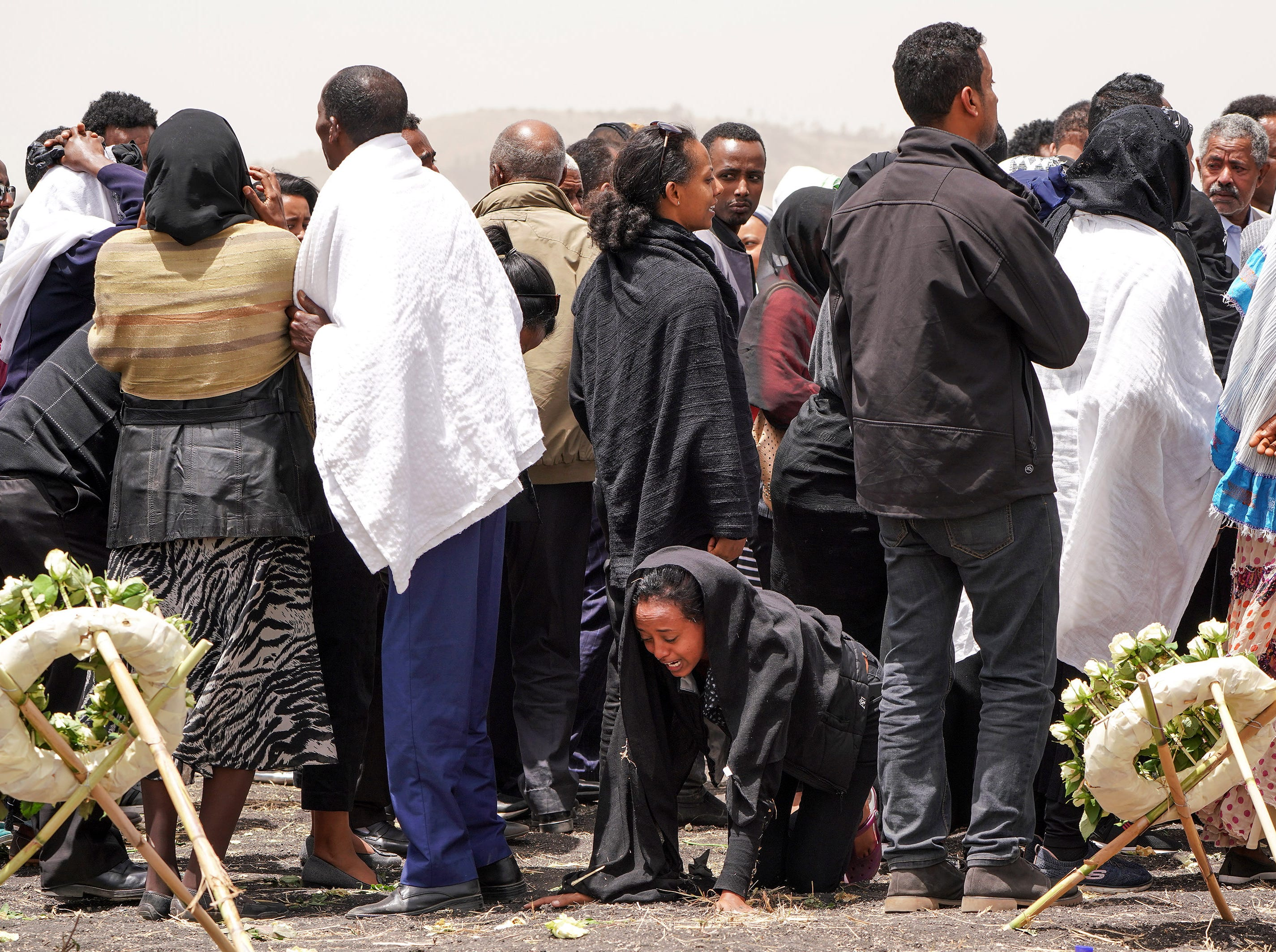 Mourners visit the crash site of Ethiopian Airlines Flight ET302 on March 14, 2019 in Ejere, Ethiopia.